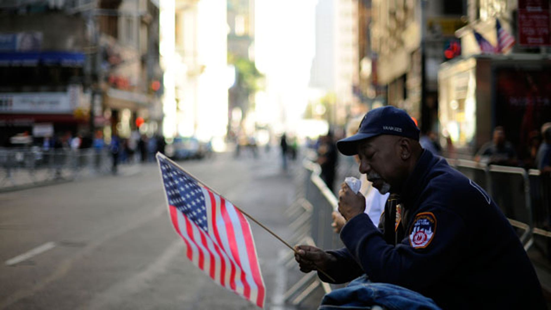 A man wipes away a tear as he listens to the reading of the names during New York City's September 11th Commemoration Ceremony on Saturday, Sept. 11, 2010, on the ninth anniversary of the terrorist attacks.