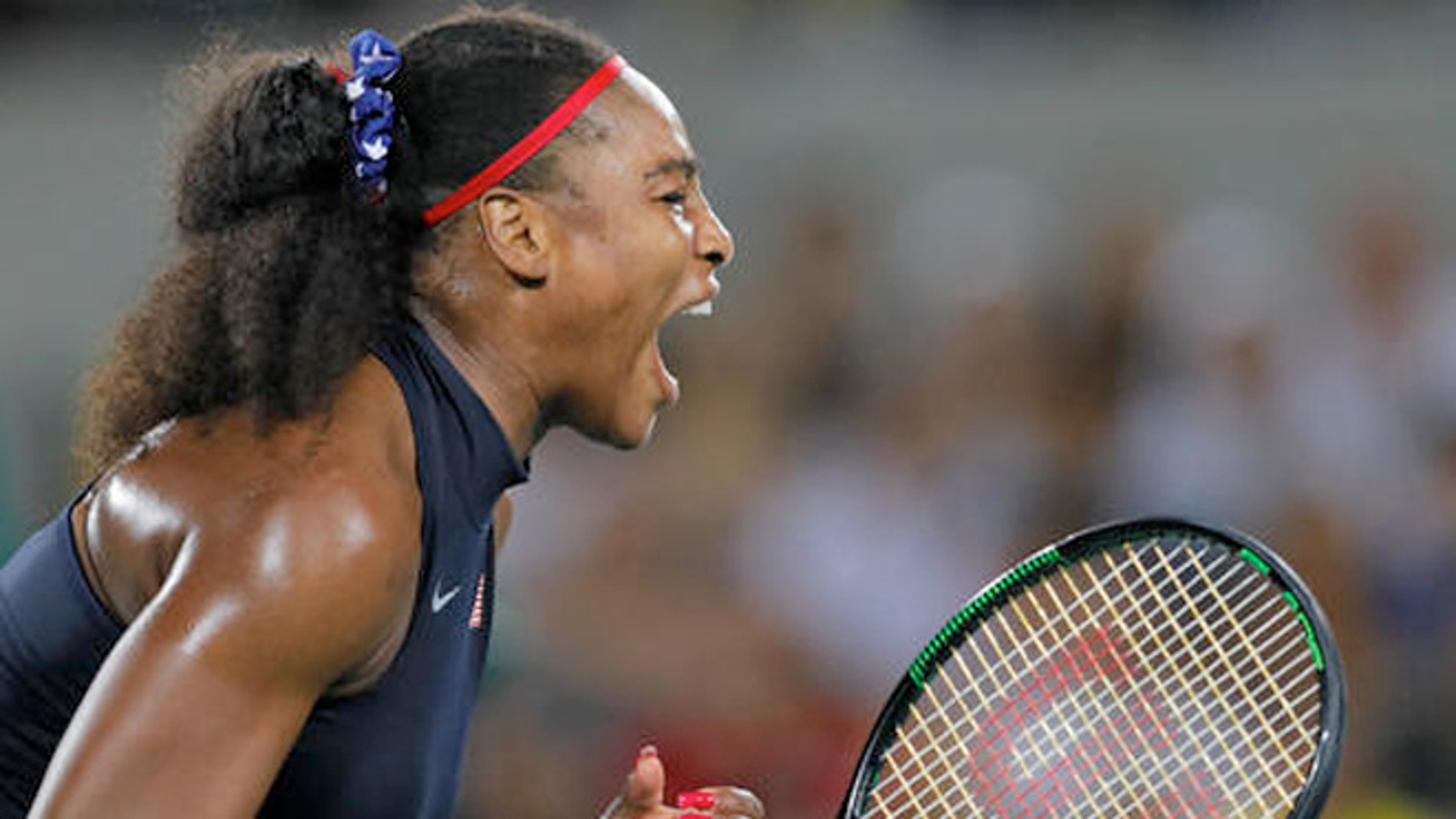 Serena Williams of the United States screams after winning a point in the match against France's Alize Cornet in the women's tennis competition at the 2016 Summer Olympics in Rio de Janeiro, Brazil, Monday, Aug. 8, 2016.