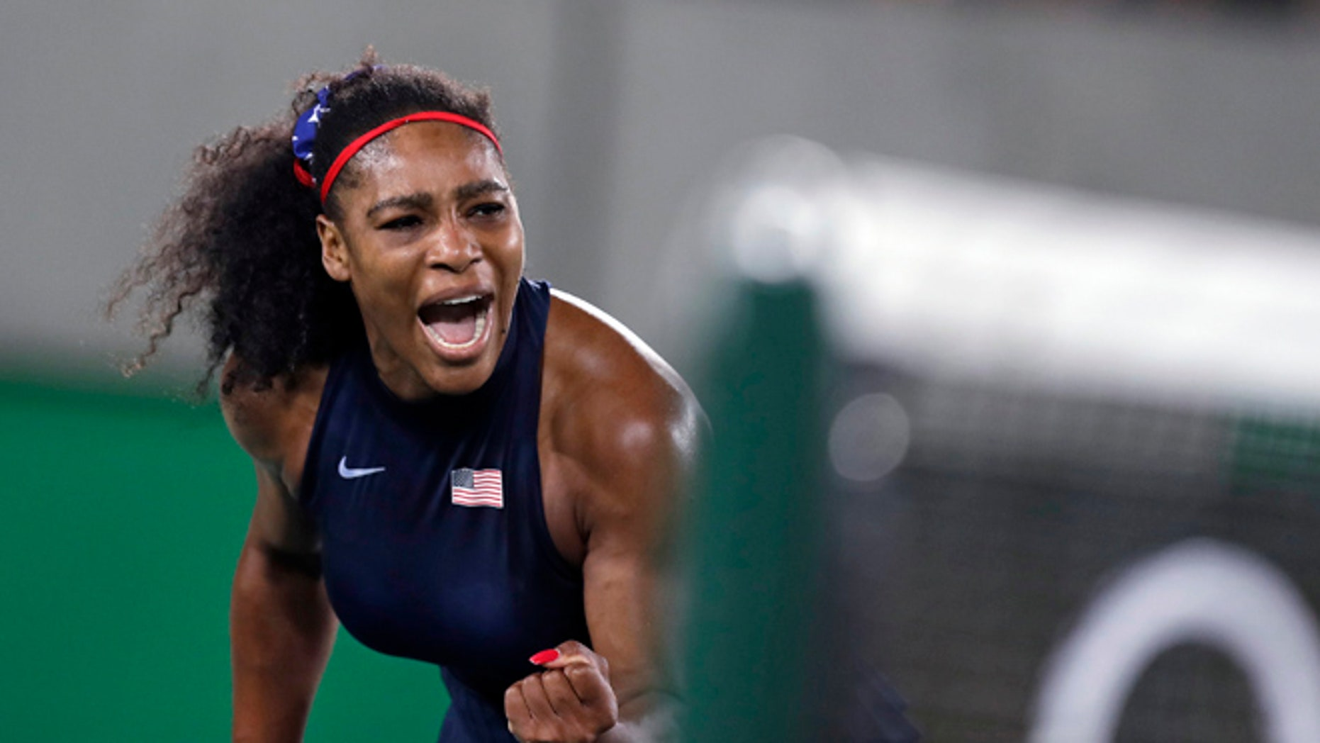 Serena Williams, of the United States, pumps her fist after winning a point at the net against Elina Svitolina, of Ukraine, at the 2016 Summer Olympics in Rio de Janeiro, Brazil, Tuesday, Aug. 9, 2016.