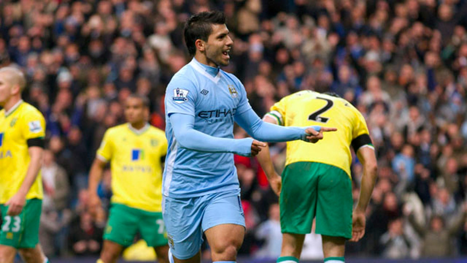 Manchester City's Sergio Aguero, center right, celebrates after scoring against Norwich during their English Premier League soccer match at The Etihad Stadium, Manchester, England, Saturday Dec. 3, 2011. (AP Photo/Jon Super)