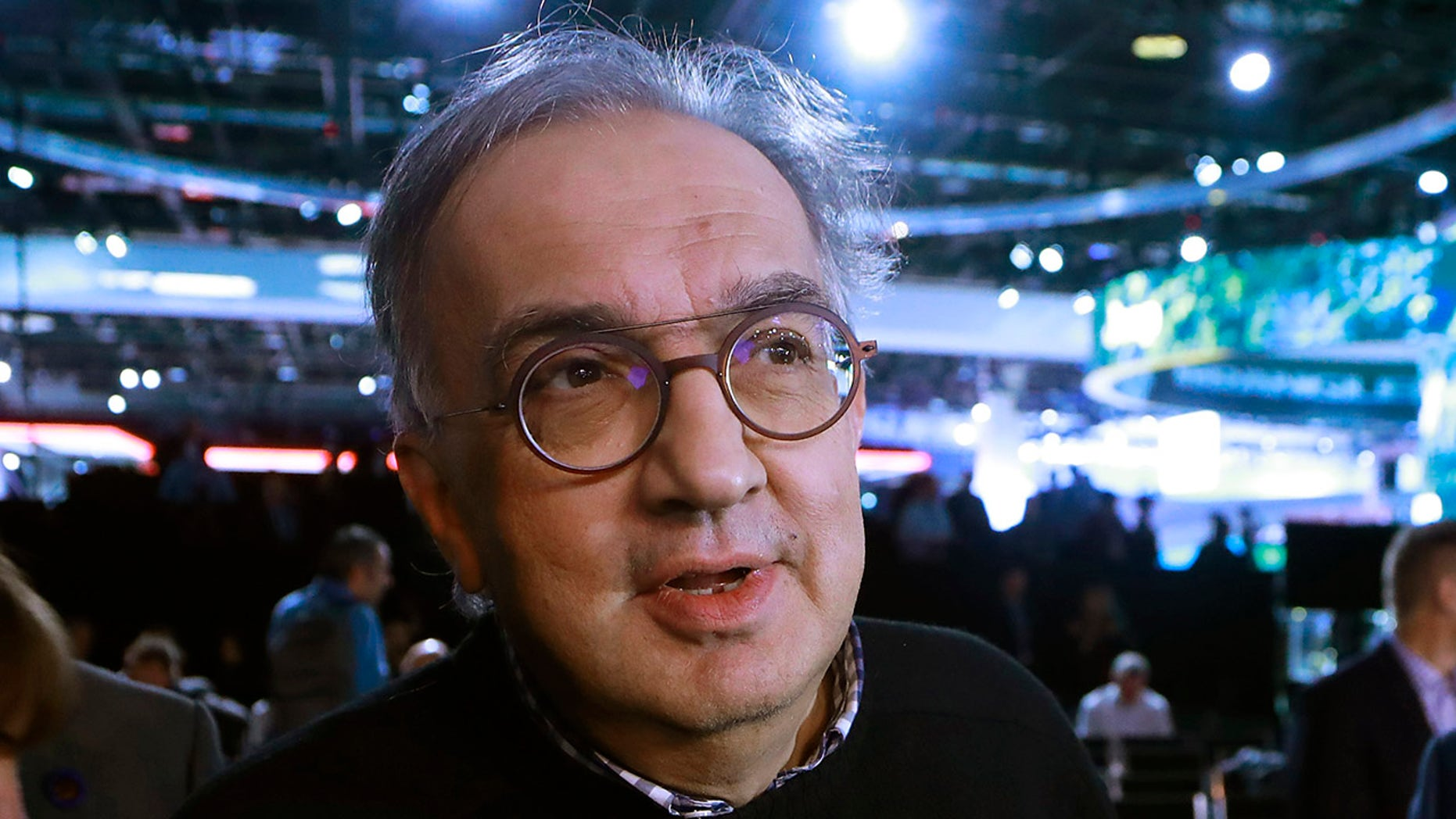 FILE - In this Tuesday, Jan. 16, 2018 filer, Fiat Chrysler Automobiles CEO Sergio Marchionne is interviewed after the unveiling of the new 2019 Jeep Cherokee during the North American International Auto Show, in Detroit. On Wednesday, July 25, 2018, holding company of Fiat founding family said Sergio Marchionne, who oversaw turnarounds of Fiat and Chrysler, has died. (AP Photo/Carlos Osorio, File )