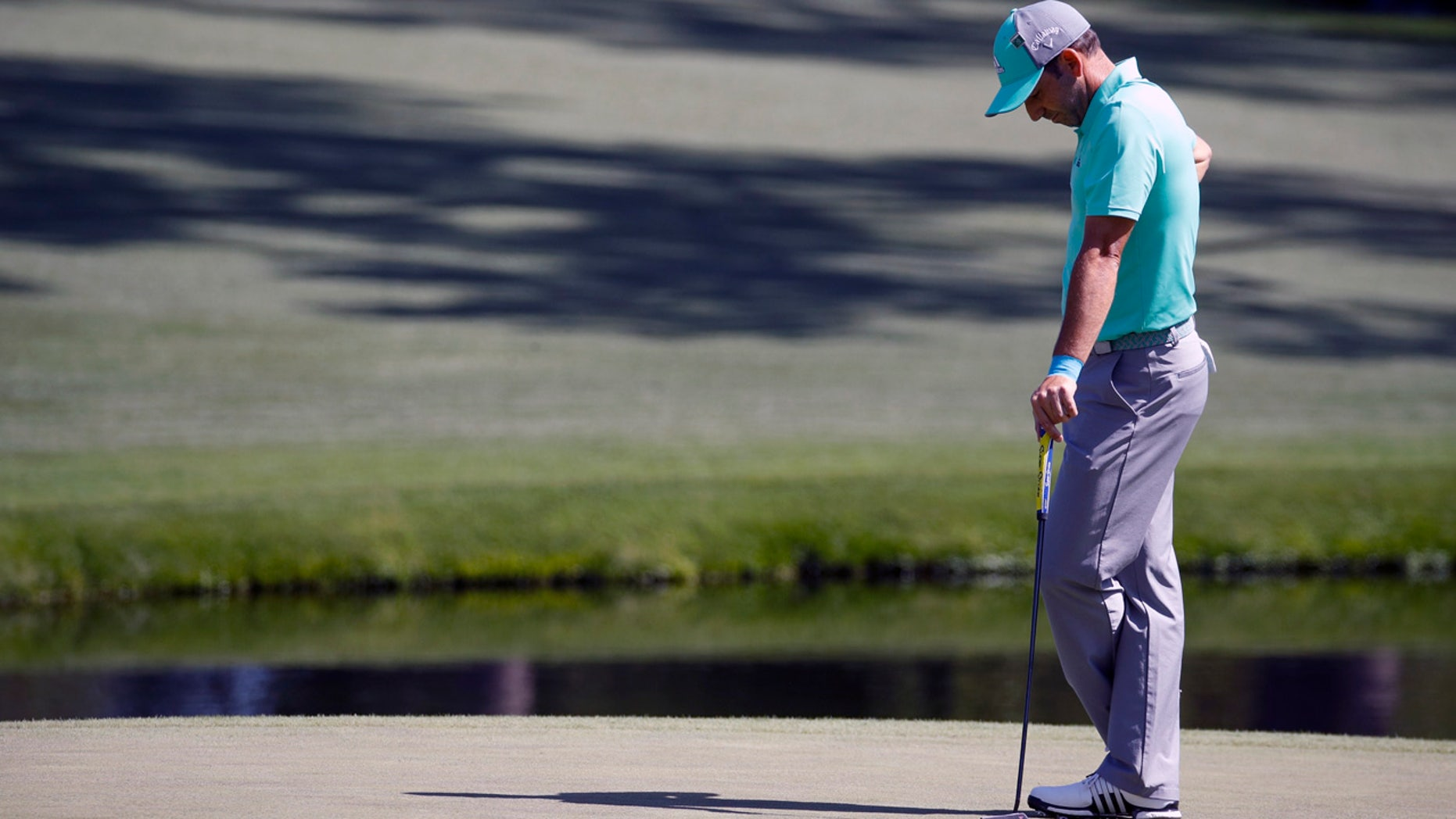 Sergio Garcia hangs his head on the 15th on his way to recording the third known 13 in Masters history.