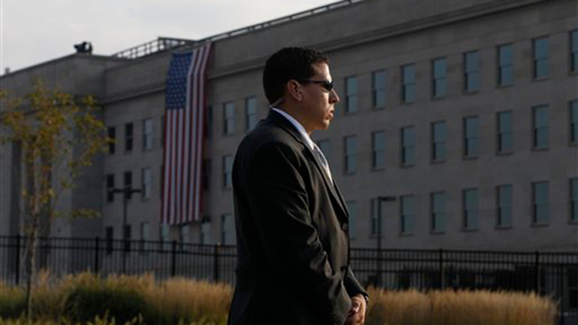 A U.S. Secret Service agent stands watch outside the Pentagon before the start of ceremonies for the 10th commemoration of the Sept. 11 attacks.