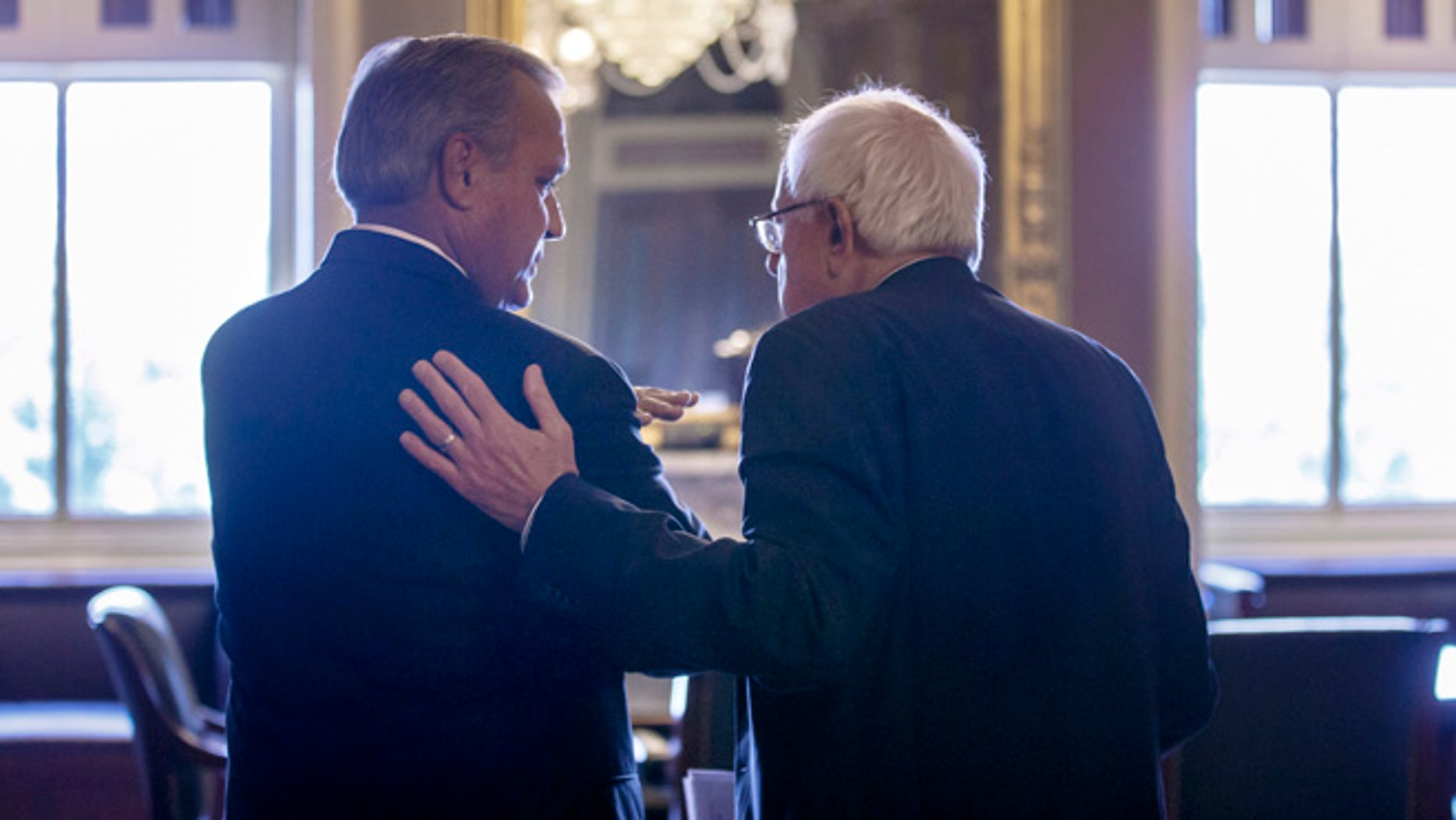 July 28, 2014: Senate Veterans Affairs Committee Chairman Sen. Bernie Sanders, I-Vt., right, and House Veterans Affairs Committee Chairman Rep. Jeff Miller, R-Fla., confer in Senate Reception before a news conference on Capitol Hill in Washington.