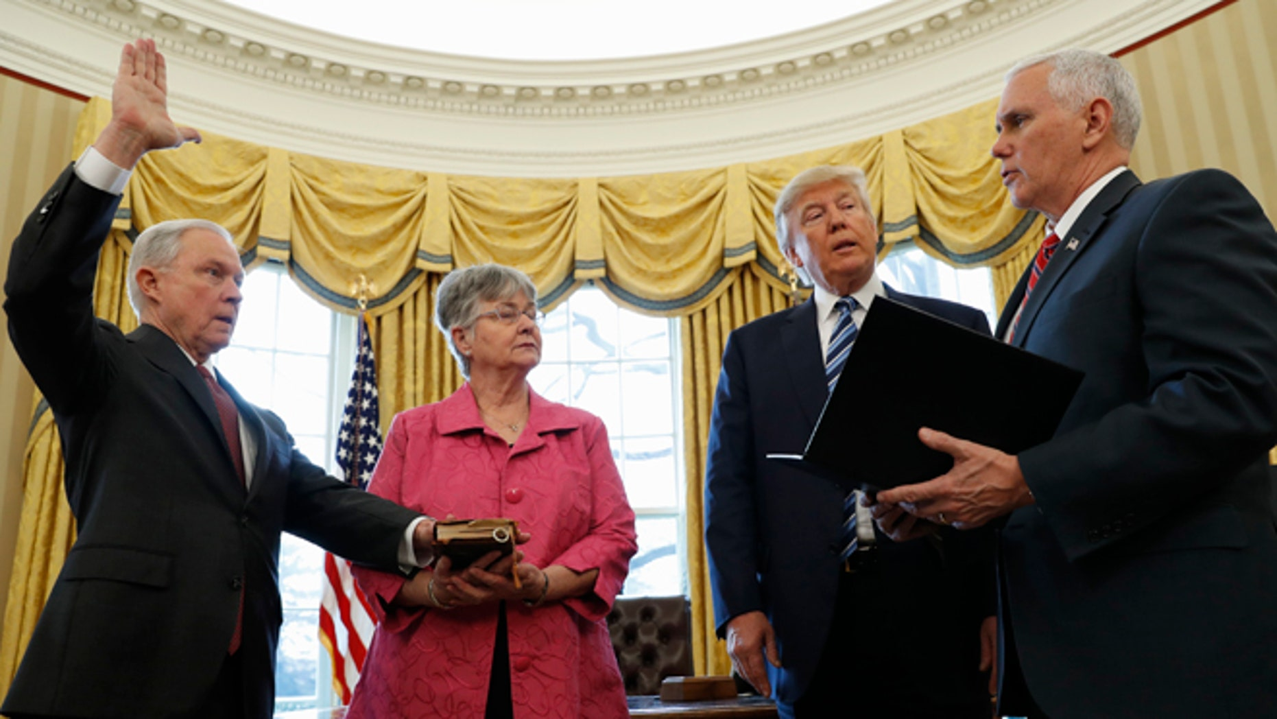 Feb. 9, 2017: President Donald Trump watches as Vice President Mike Pence administers the oath of office to Attorney General Jeff Sessions, accompanied by his wife Mary in the Oval Office of the White House in Washington.