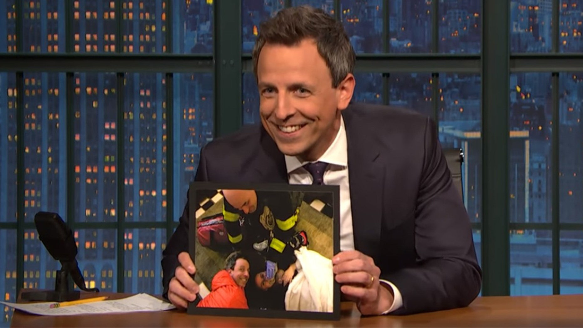 "Seth Meyers shows off photos of wife giving birth to their second son in their hotel lobby on Monday's night ""Late Night with Seth Meyers."""