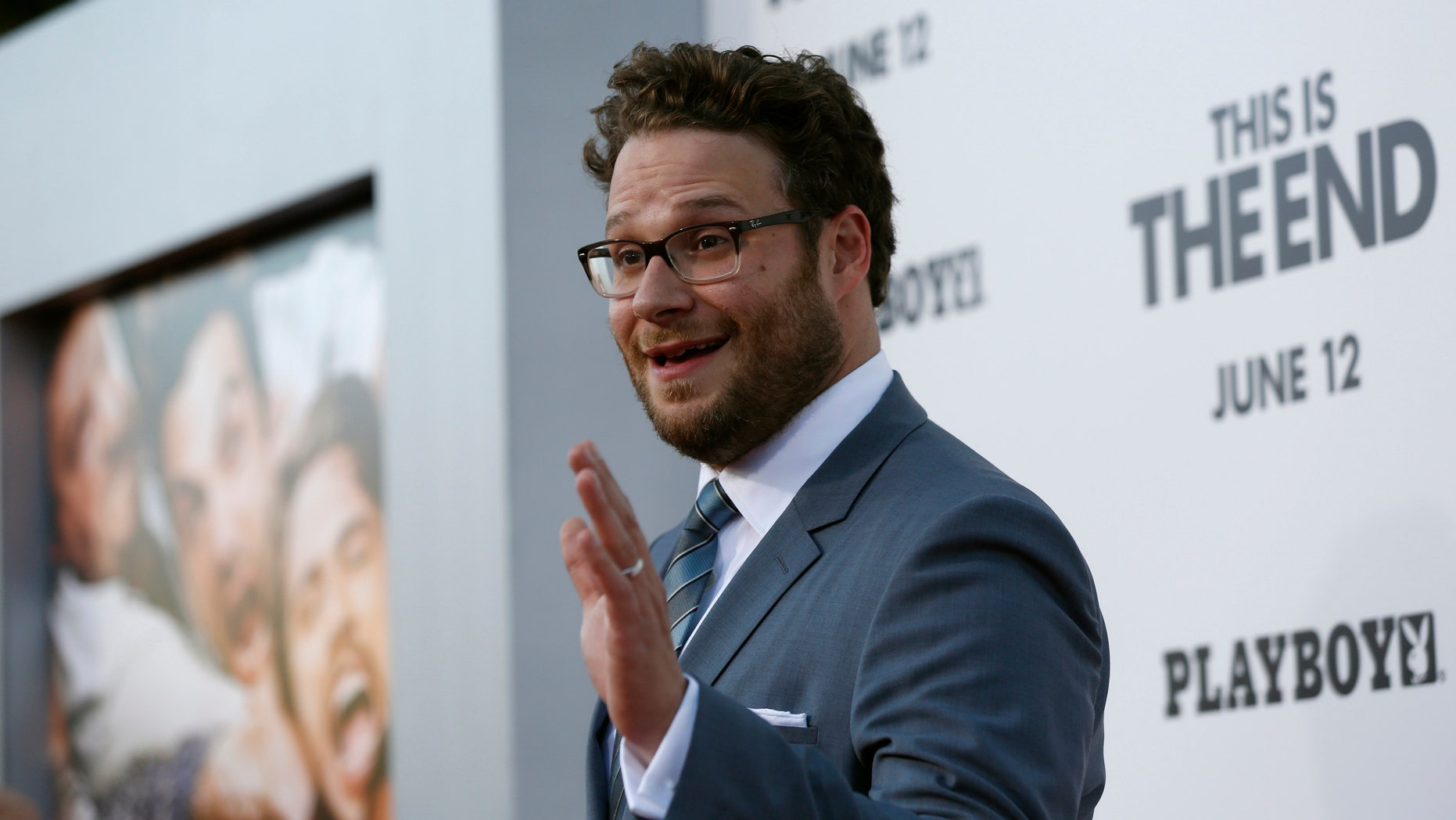 """June 3, 2013. Director, writer and cast member Seth Rogen waves at the premiere of """"This Is the End"""" at the Regency Village Theatre in Los Angeles, California."""