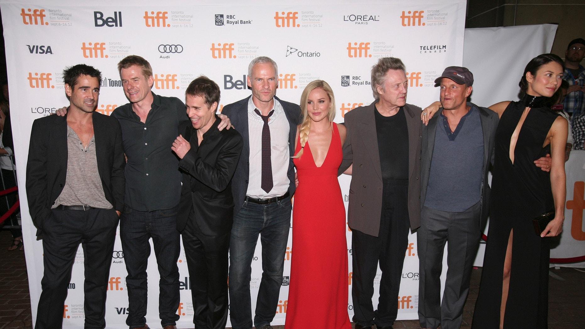 "(L to R) Colin Farrell, Graham Broadbent, Sam Rockwell, Martin McDonagh, Abbie Cornish, Christopher Walken, Woody Harrelson, and Olga Kurylenko, at the ""Seven Psychopaths"" premiere in Toronto."