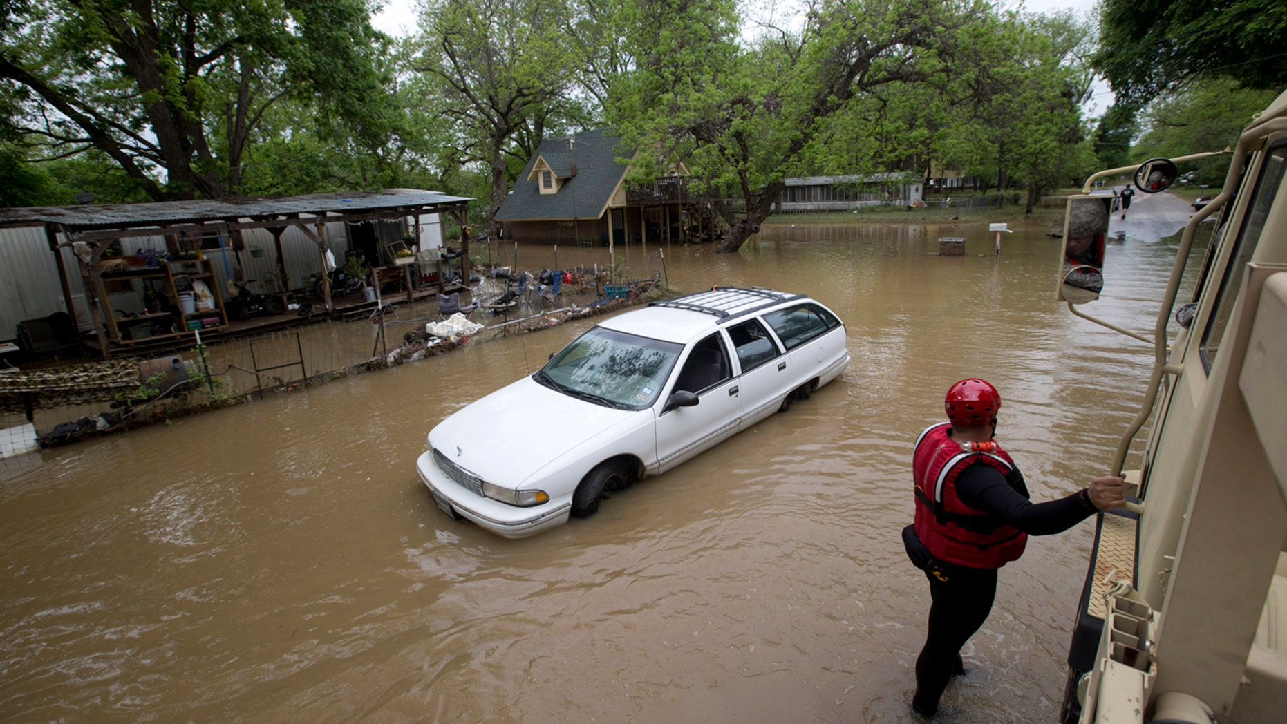 April 19, 2016: Volunteer firefighters/swift water rescuers from Springcreek Volunteer FD station 3 in Horseshoe Bend, Texas, check on the welfare of residents who decided to stay in their homes during the Brazos river flooding in the Horseshoe Bend area of Parker County.