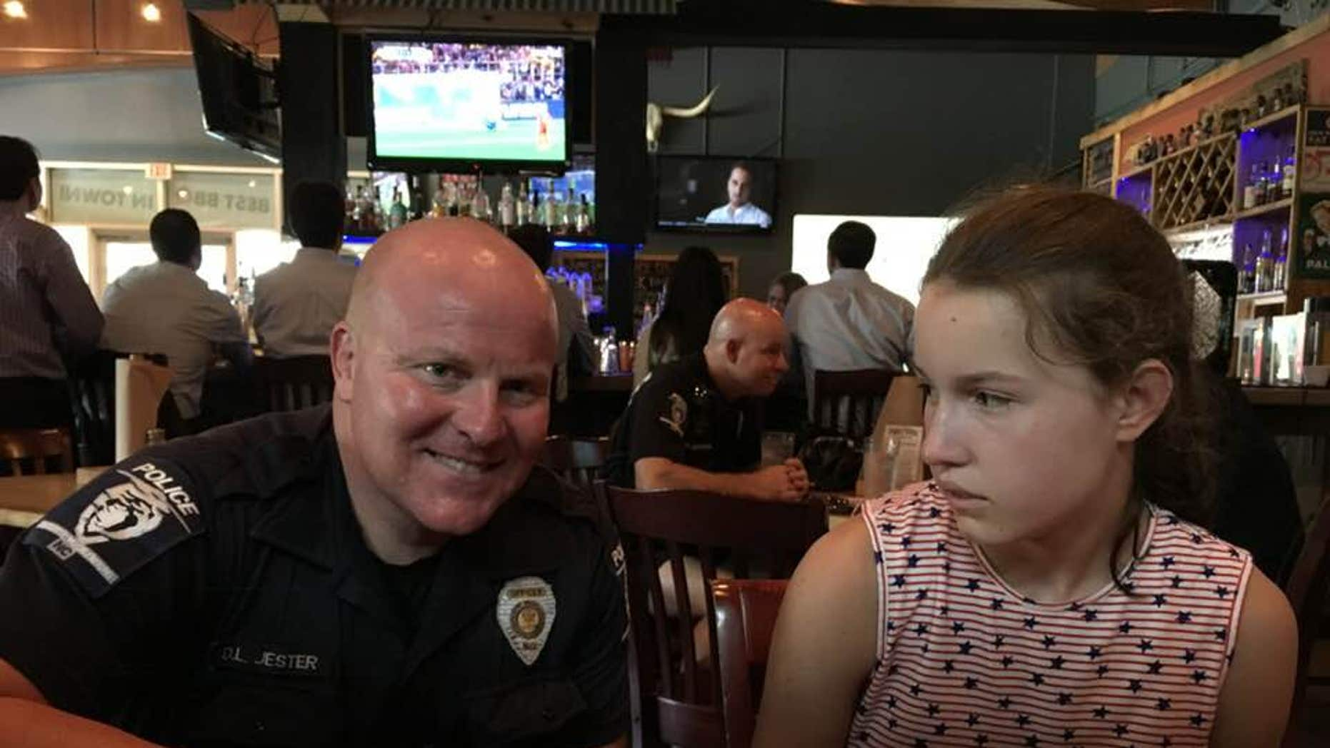 Cindy Frederick is grateful for a Charlotte-Mecklenburg Police officer who took time away from his meal to sit with her family and take a picture with her daughter in an effort to teach her that law enforcement can help her if ever needed.