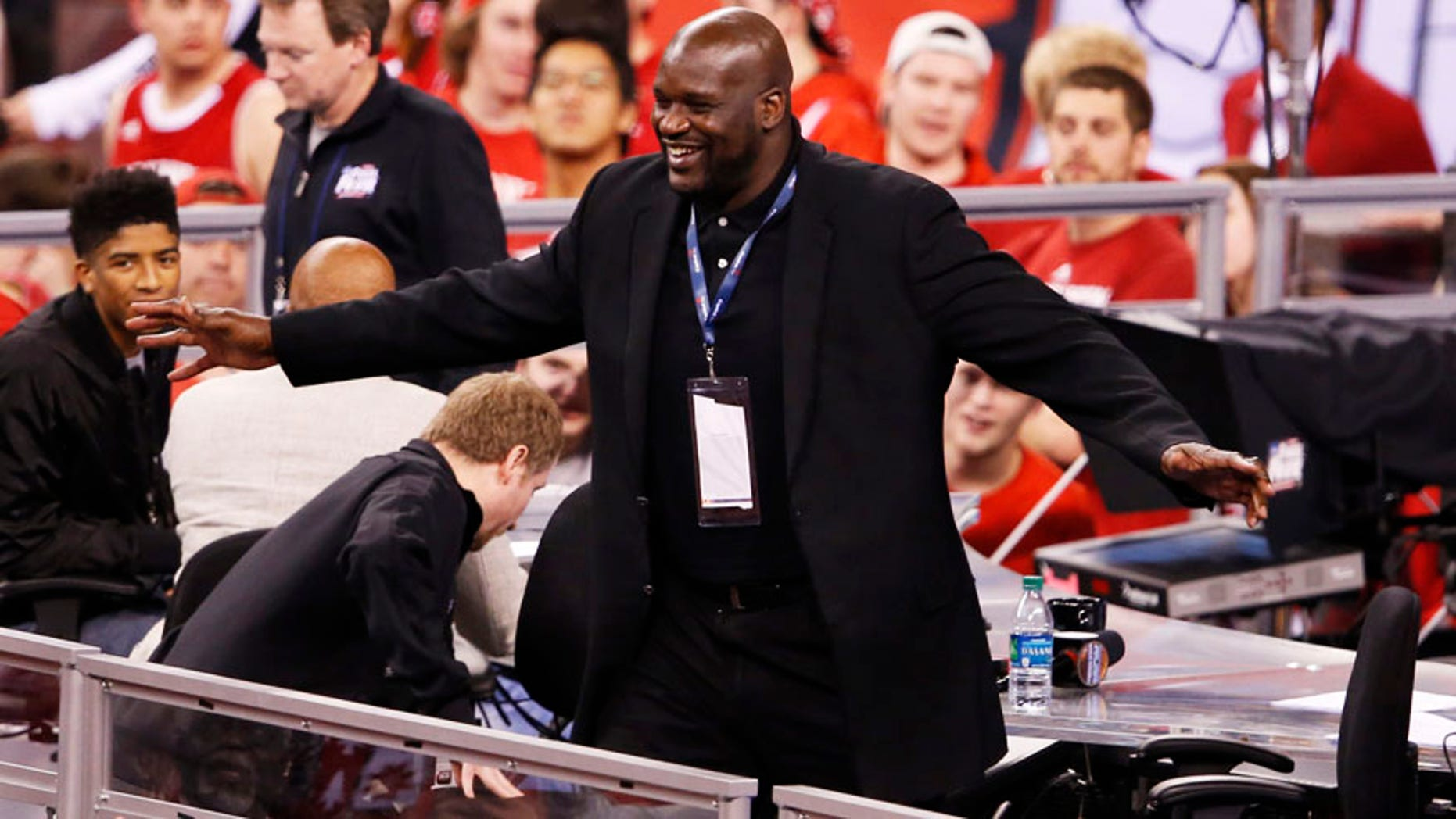 Apr 4, 2015; Indianapolis, IN, USA; Former basketball player Shaquille O'Neal greets fans during the second half of the 2015 NCAA Men's Division I Championship semi-final game between the Kentucky Wildcats and the Wisconsin Badgers at Lucas Oil Stadium. Mandatory Credit: Brian Spurlock-USA TODAY Sports - RTR4W4T2