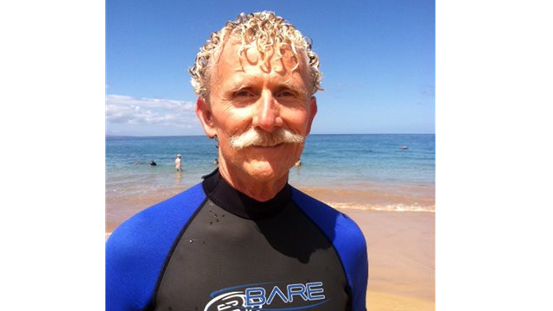 Aug. 15, 2013: Rick Moore poses at Palauea Beach in Makena on the island of Maui, Hawaii, a day after he jumped into the water to rescue a shark attack victim who lost her arm.
