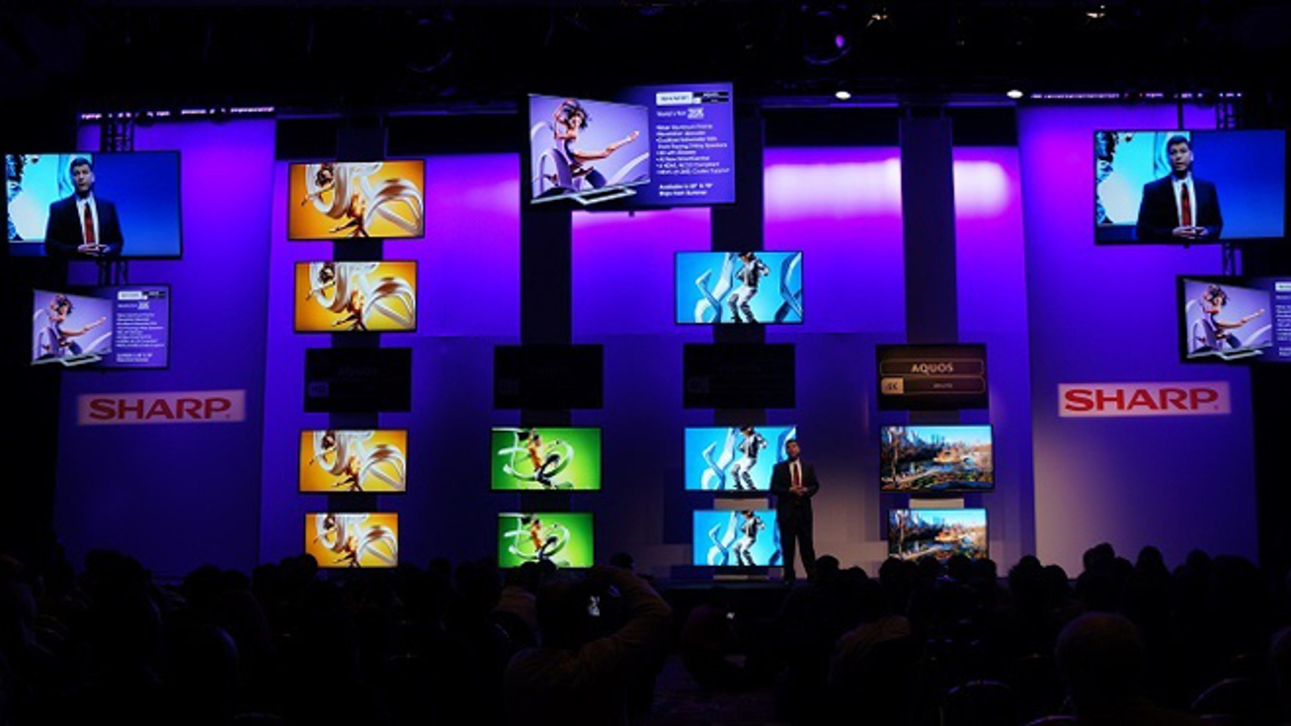 A Sharp executive speaks onstage during a presentation at the 2014 Consumer Electronics Show.
