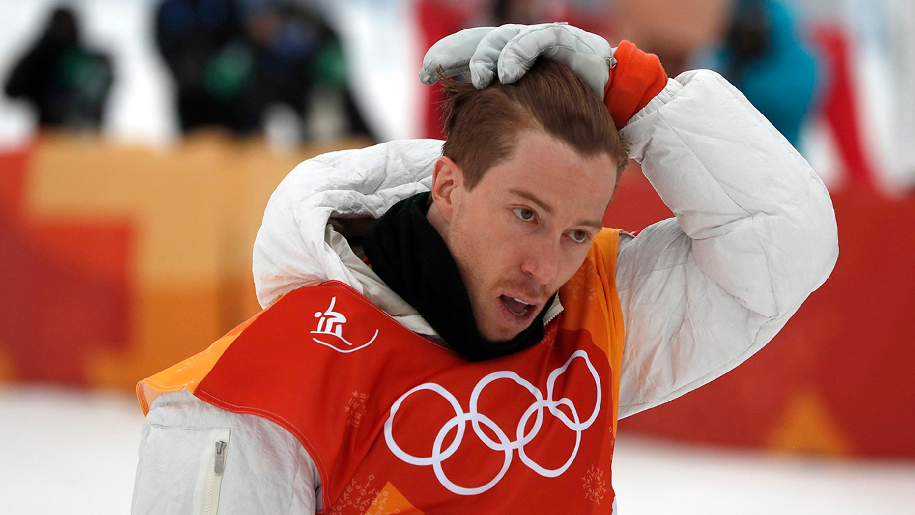 Shaun White was lit up on social media after appearing to drag the American flag on the ground.