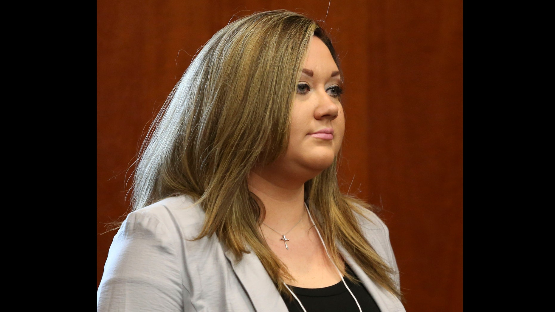 SANFORD, FL - JUNE 20: George Zimmerman's wife, Shellie Zimmerman, enters the courtroom following a recess in his trial in Seminole circuit court June 20, 2013 in Sanford, Florida.