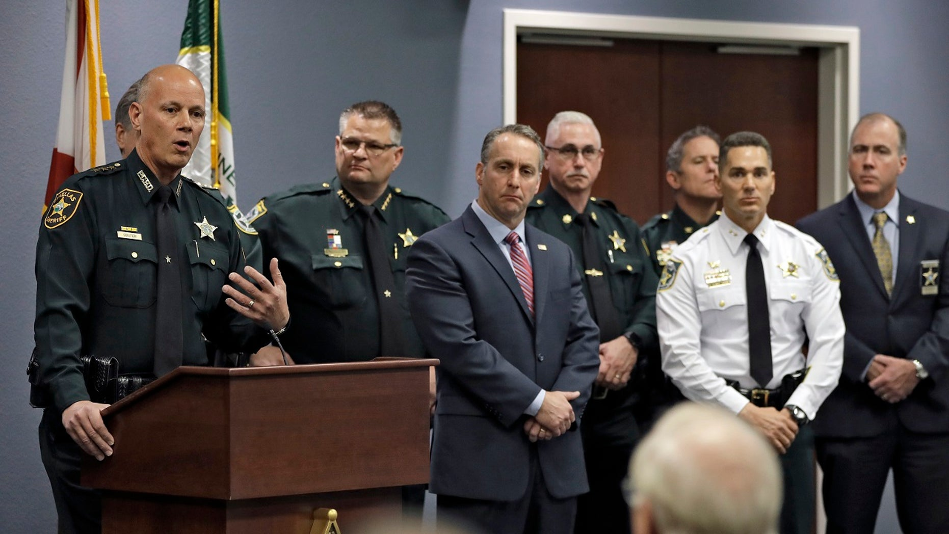 More than a dozen Florida law enforcement agencies have penned a deal with federal immigration officials allowing local police to detain illegal immigrants held on criminal charges.