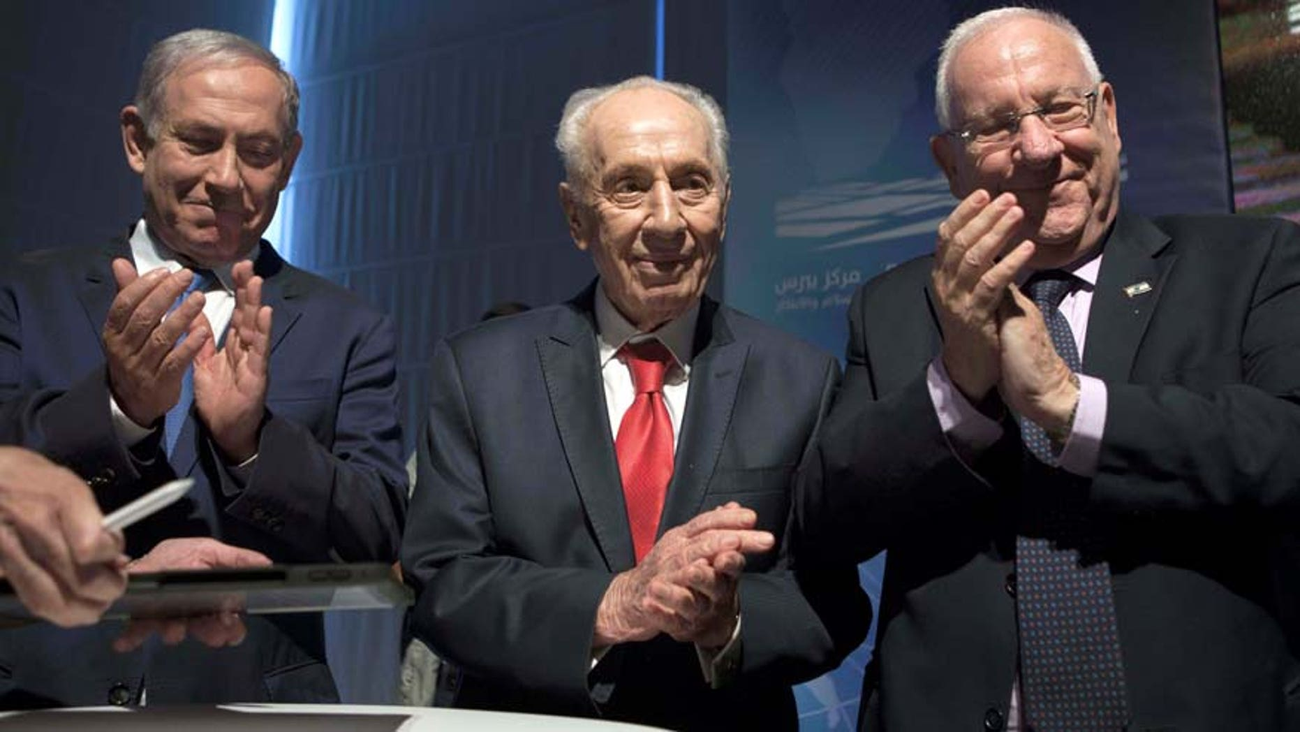 July 21, 2016: Israeli Prime Minister Benjamin Netanyahu, left, former Israeli President Shimon Peres, center, and Israel's President Reuven Rivlin are seen during a ceremony at the Peres Center for Peace in Jaffa, Israel.