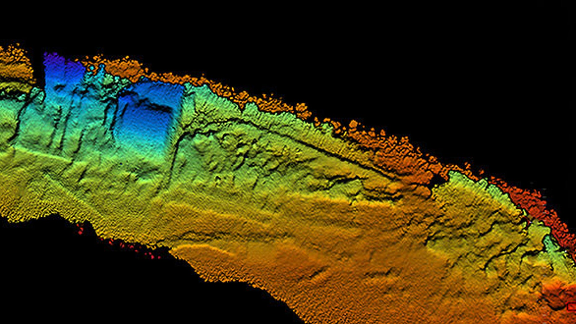 Coda Octopus 3-D Echoscope sonar, downward view of the shipwreck SS City of Chester with sternpost, (left side of sonar image) compound steam engine and boilers (in blue middle of sonar image), and bow (right side of sonar image).