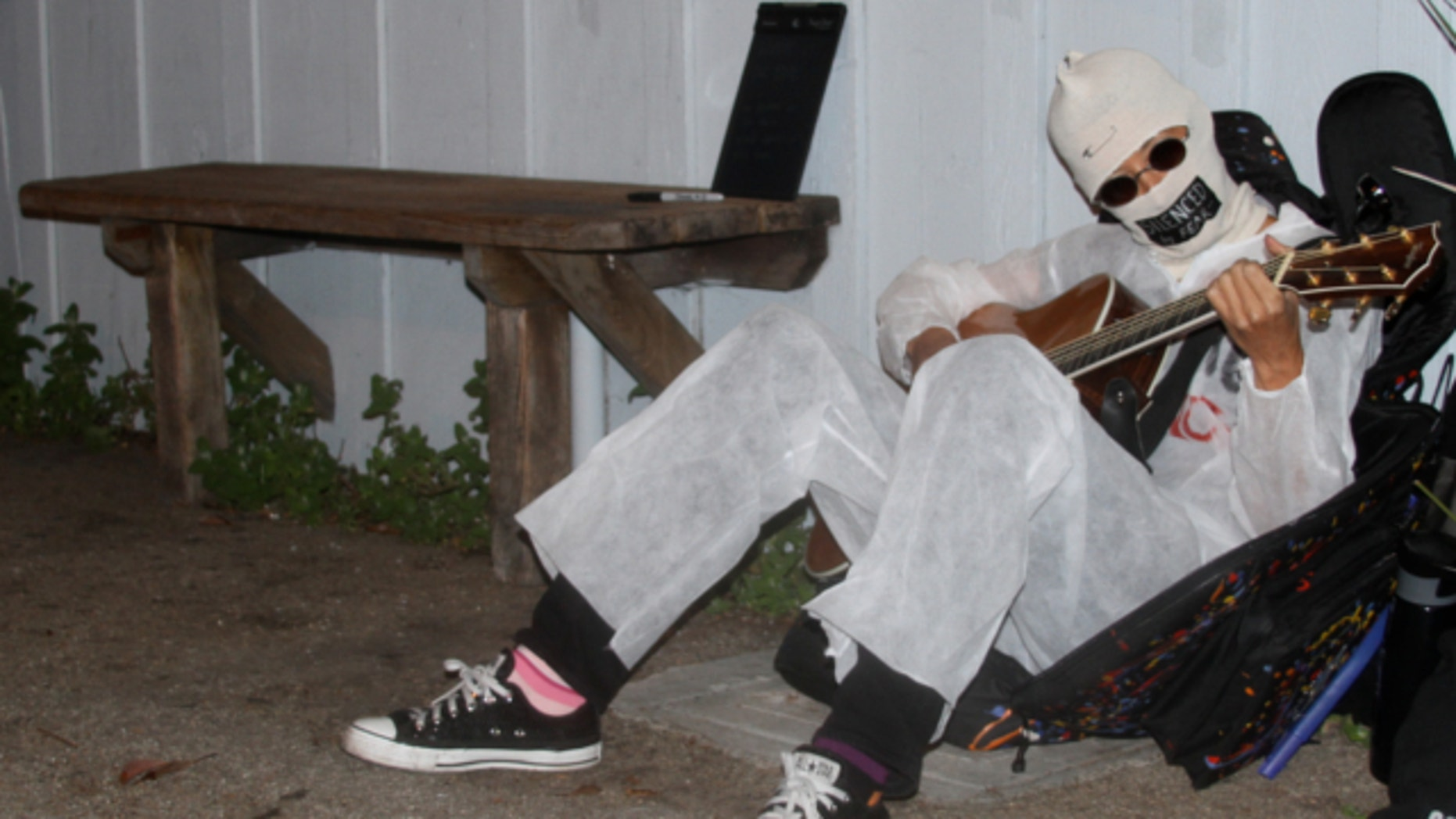 March 28, 2013: Alternative folk singer Michelle Shocked sits outside Moe's Alley nightclub in Santa Cruz Calif., and strums her guitar.