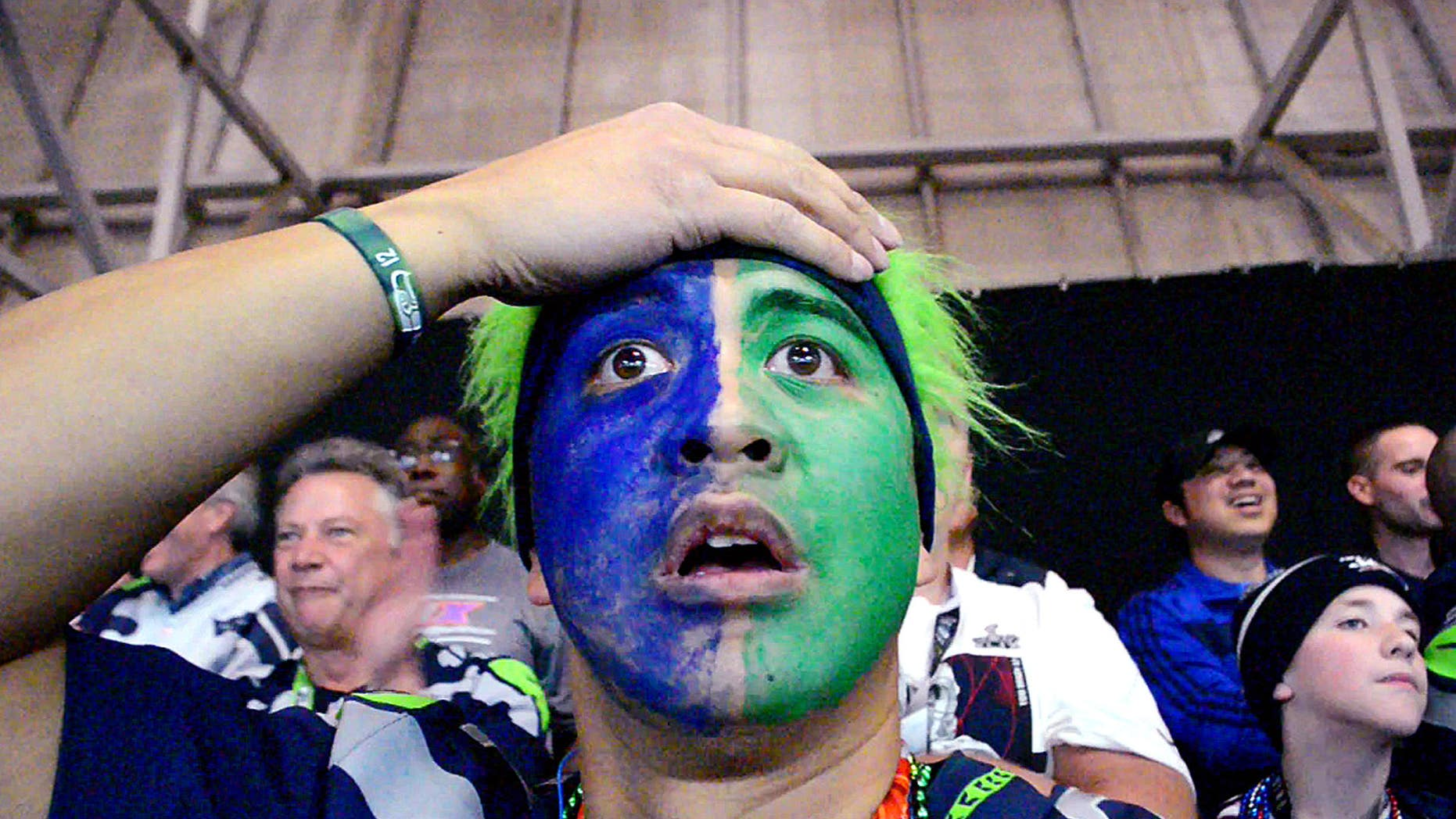 Feb. 1, 2015:  Seattle Seahawks' fan grabs his head in the final moments of the Super Bowl as the Seahawks lose to the New England Patriots.