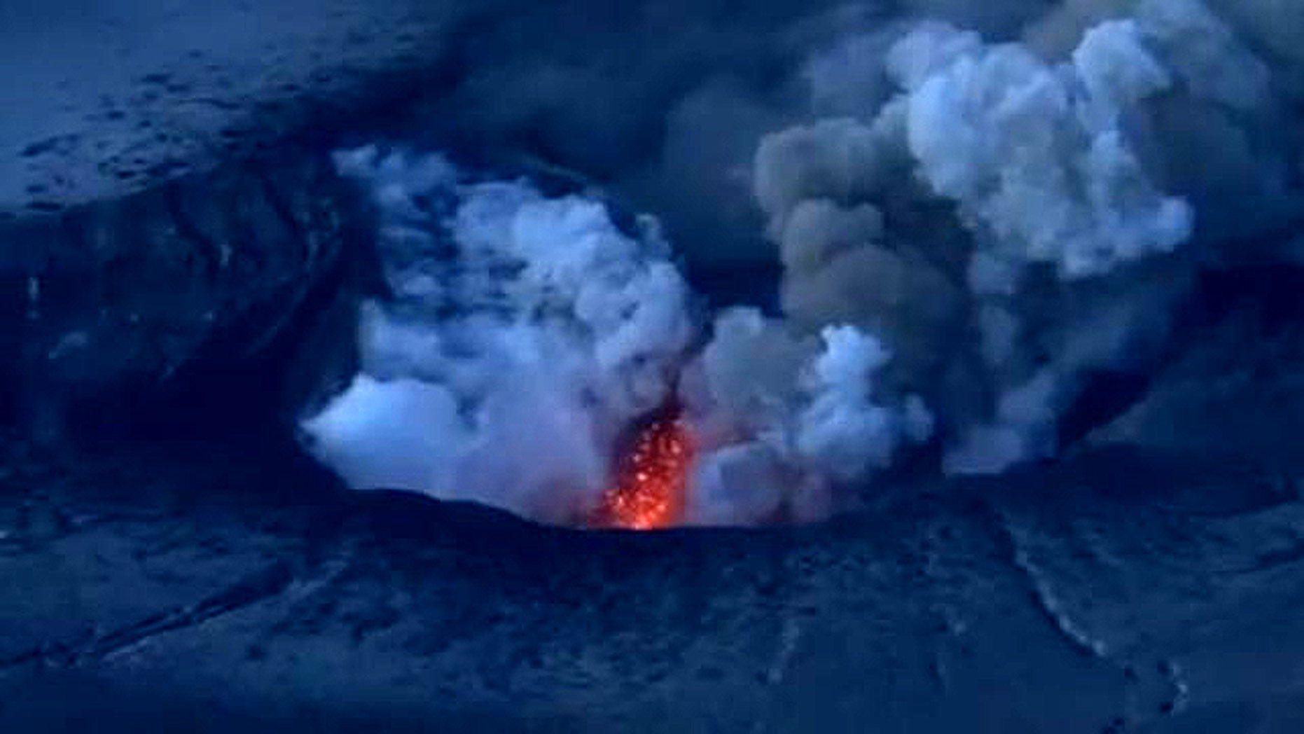 Though hard to make out in this screen capture, a YouTube video clearly shows shockwaves pouring out of Iceland's erupting Eyjafjallajokull volcano.