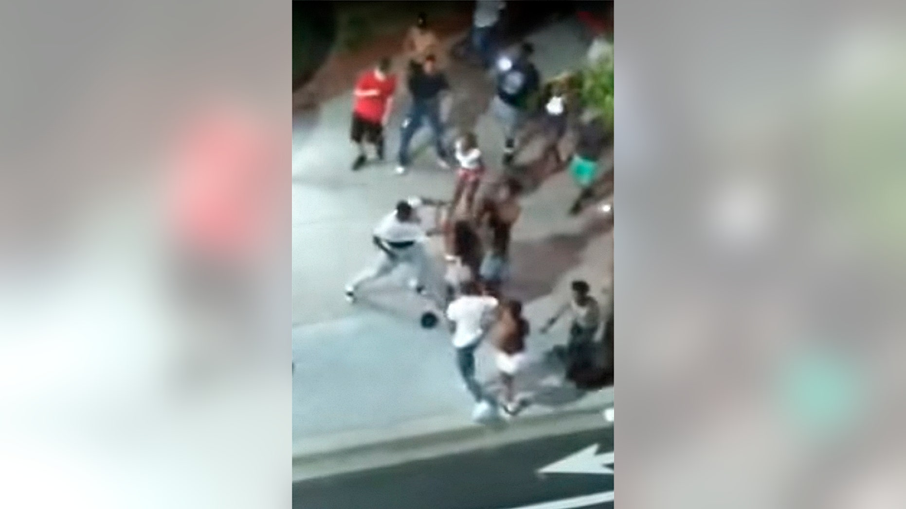 Screen shot from Facebook Live video that captured a shooting early Sunday in Myrtle Beach, S.C., shows man in white t-shirt reaching for a gun.