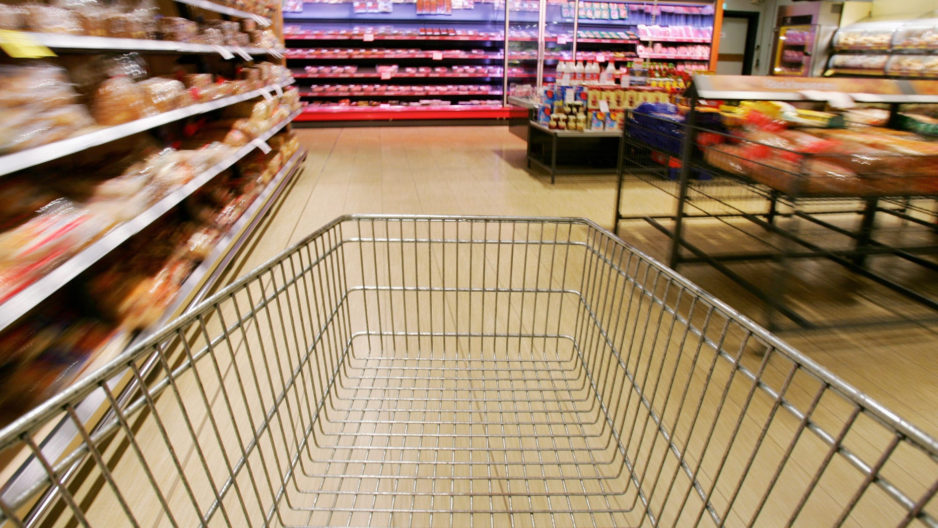 LUNEBURG, GERMANY - JULY 26:  In this photo illustration, a shopping cart rolls down the isles of a supermarket on July 26, 2005 in Luneburg, Germany. Sparked by the election manifesto of the opposition party CDU, Germany currently debates whether raising the Mehrwertsteuer (VAT) would in fact promote economic growth or if it would have the opposite effect by hurting families and low-income households.  (Photo by Andreas Rentz/Getty Images)
