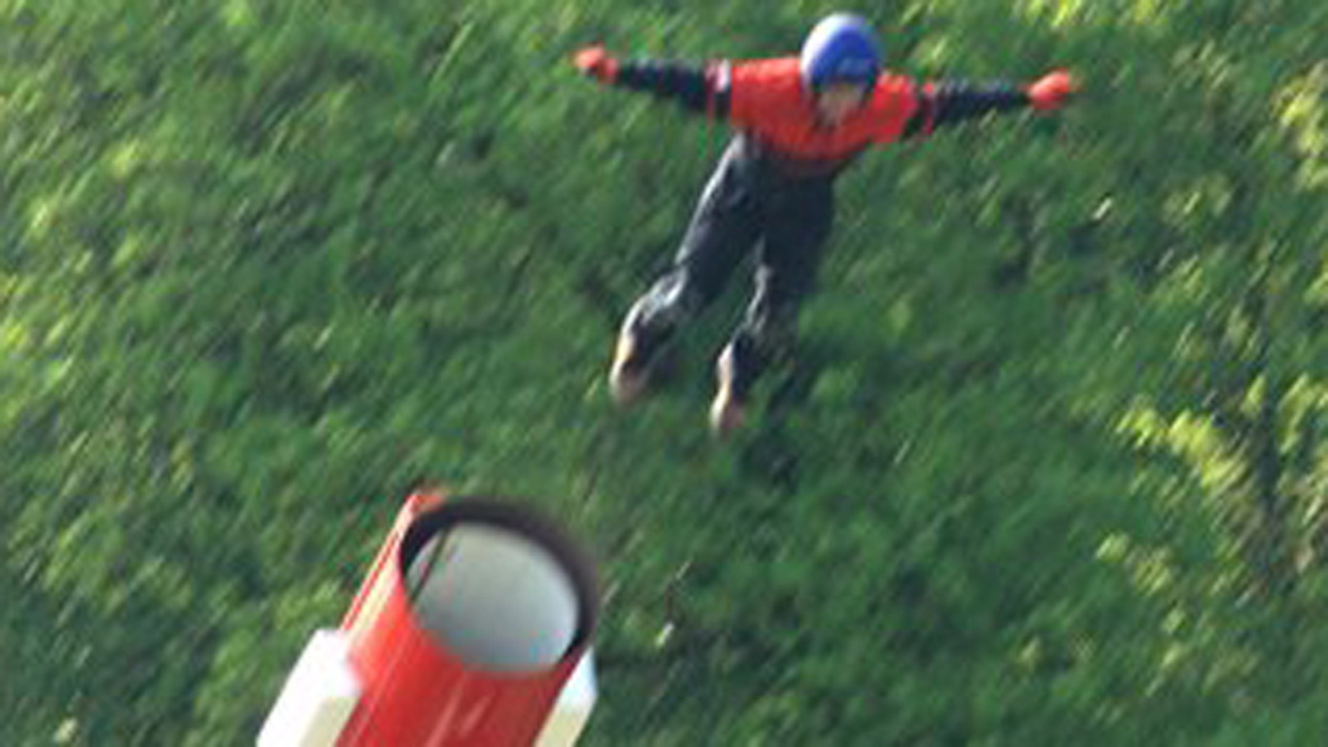 April 25: A human cannonball  is propelled from the barrel moments before he died after a safety net failed during the stunt at the Kent County Showground in Detling, south eastern England