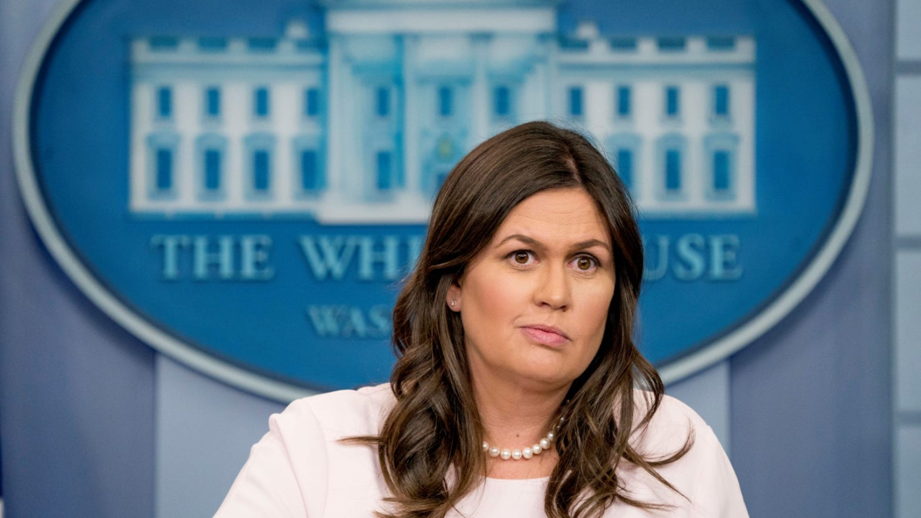 White House press secretary Sarah Sanders hit back Wednesday night against reports that she was considering leaving her role.