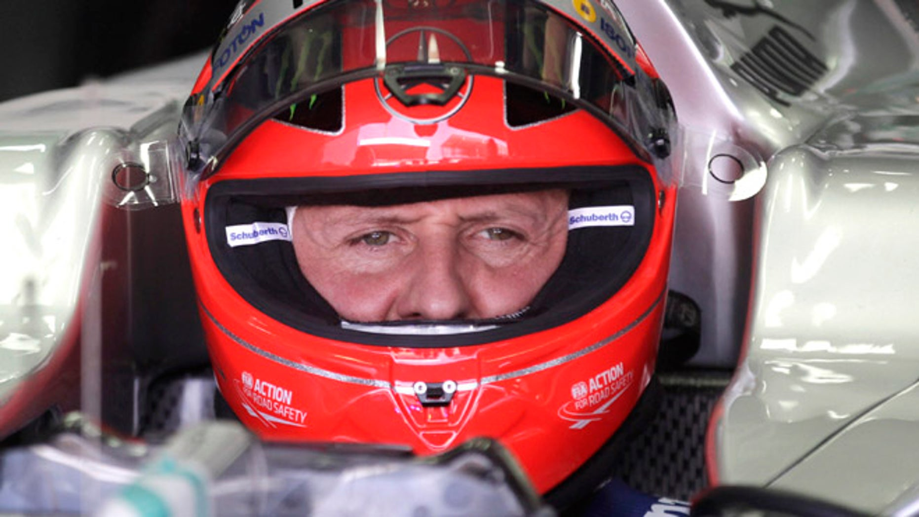 FILE - In this Nov. 23, 2012 file photo, Grand Prix driver Michael Schumacher, of Germany, sits in his car during a free practice at the Interlagos race track in Sao Paulo, Brazil. (AP Photo/Victor Caivano, File)