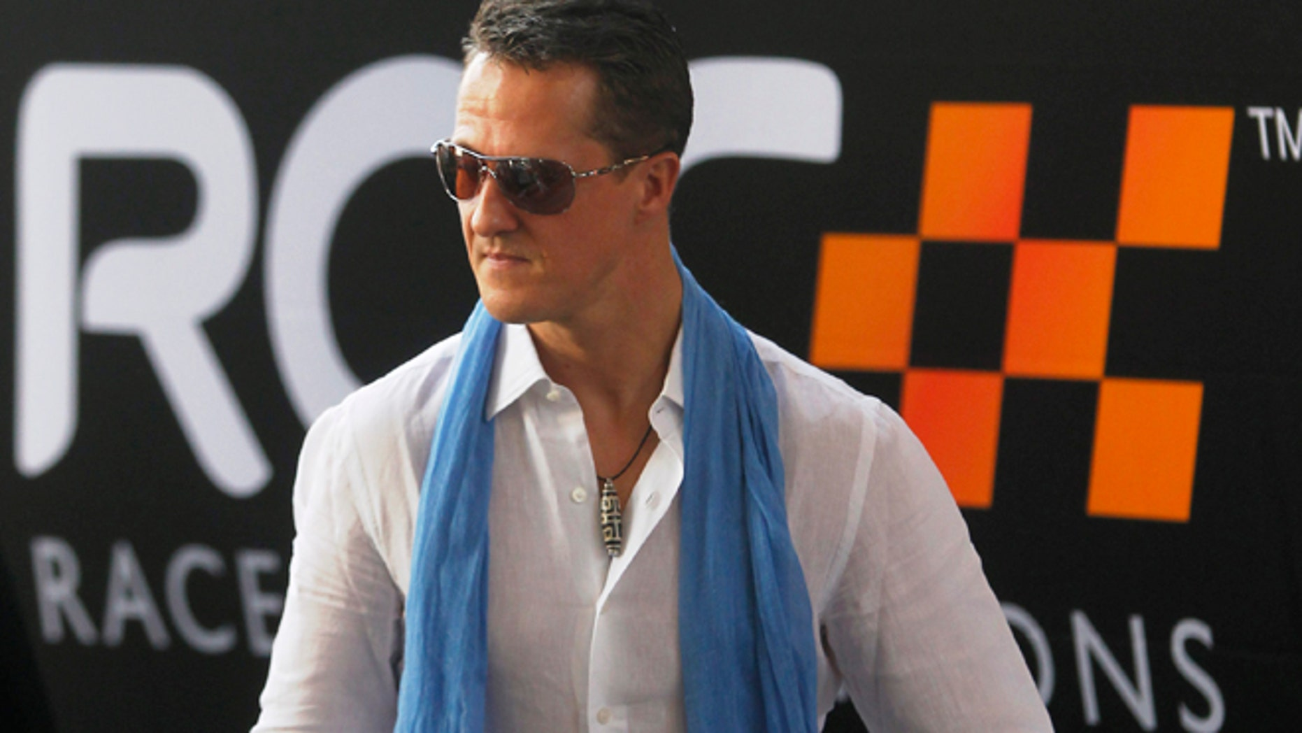 Driver Michael Schumacher from Team Germany arrives at the Rajamangala National Stadium before a practice for the Race of Champions (ROC) in Bangkok December 16, 2012. The Race of Champions runs from December 14 to 16. REUTERS/Chaiwat Subprasom (THAILAND - Tags: SPORT MOTORSPORT) - RTR3BML4