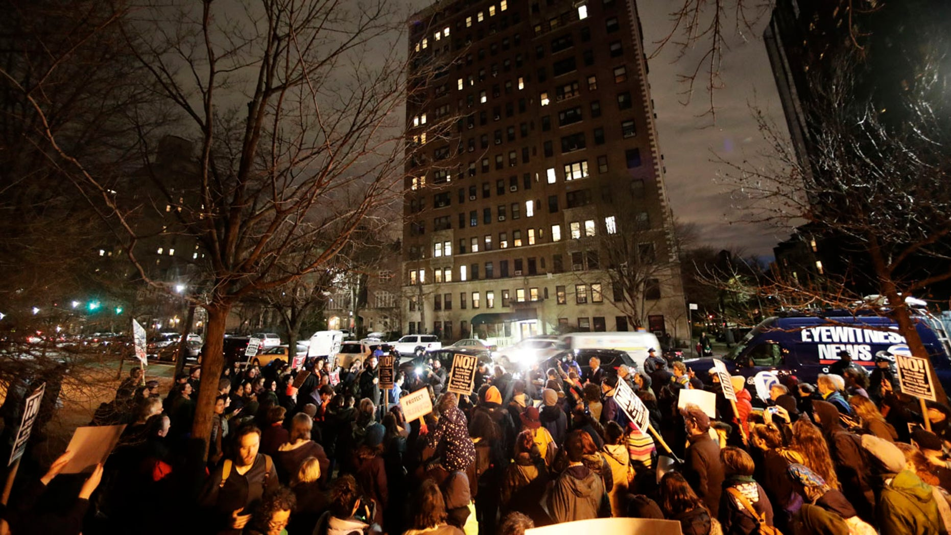 Protesters gather across the street from the home of U.S. Sen. Chuck Schumer, D-N.Y., in Brooklyn, N.Y.