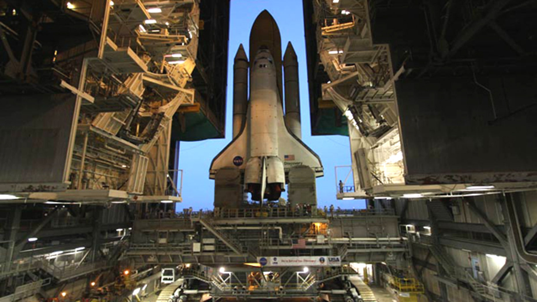 Space shuttle Discovery moves out of the cavernous Vehicle Assembly Building for the last time on Sept. 20, 2010 to prepare for its final mission to the International Space Station.