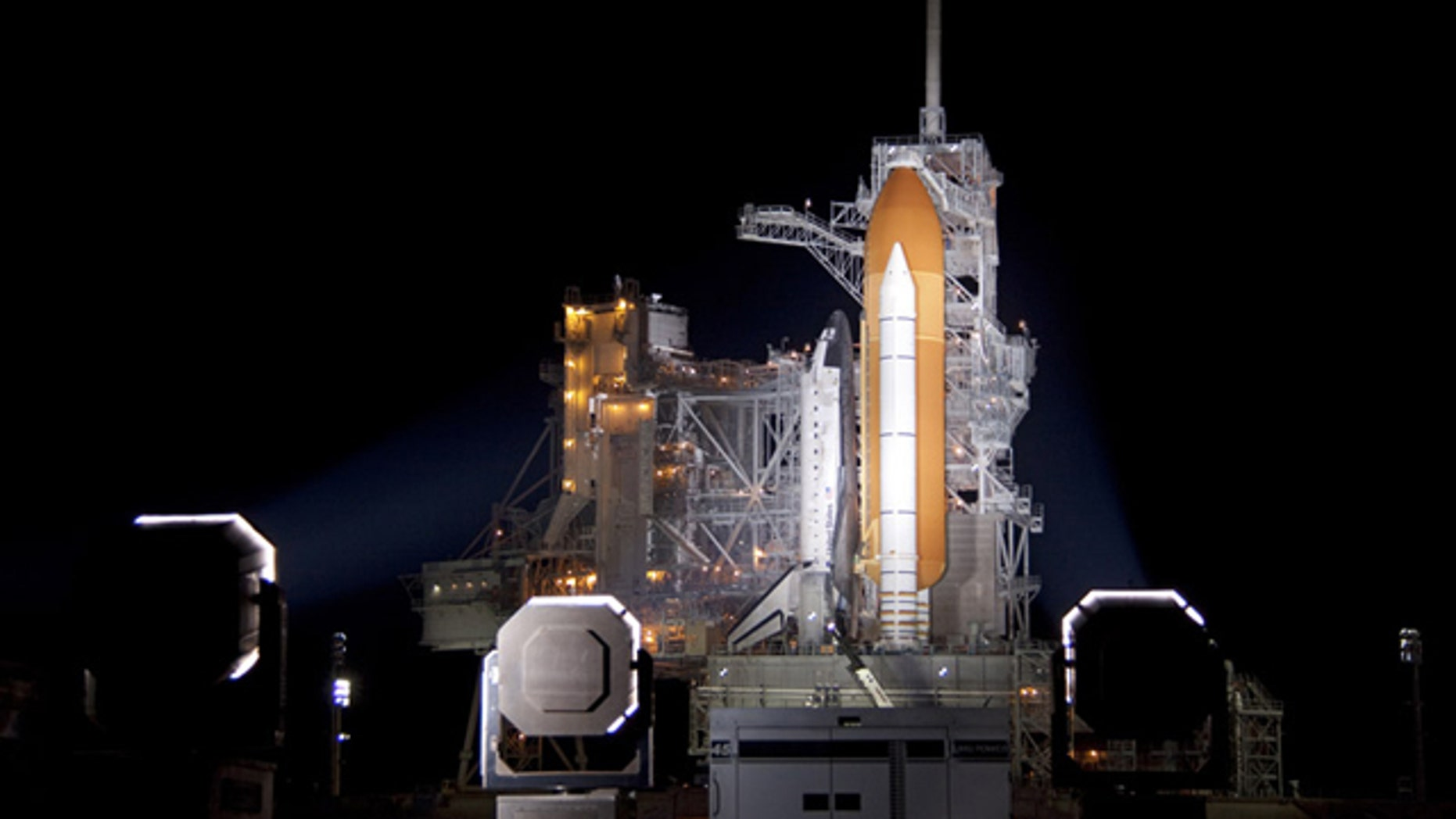At NASA's Kennedy Space Center in Florida, xenon lights illuminate space shuttle Discovery on Launch Pad 39A following the retraction of the rotating service structure on Nov. 3.