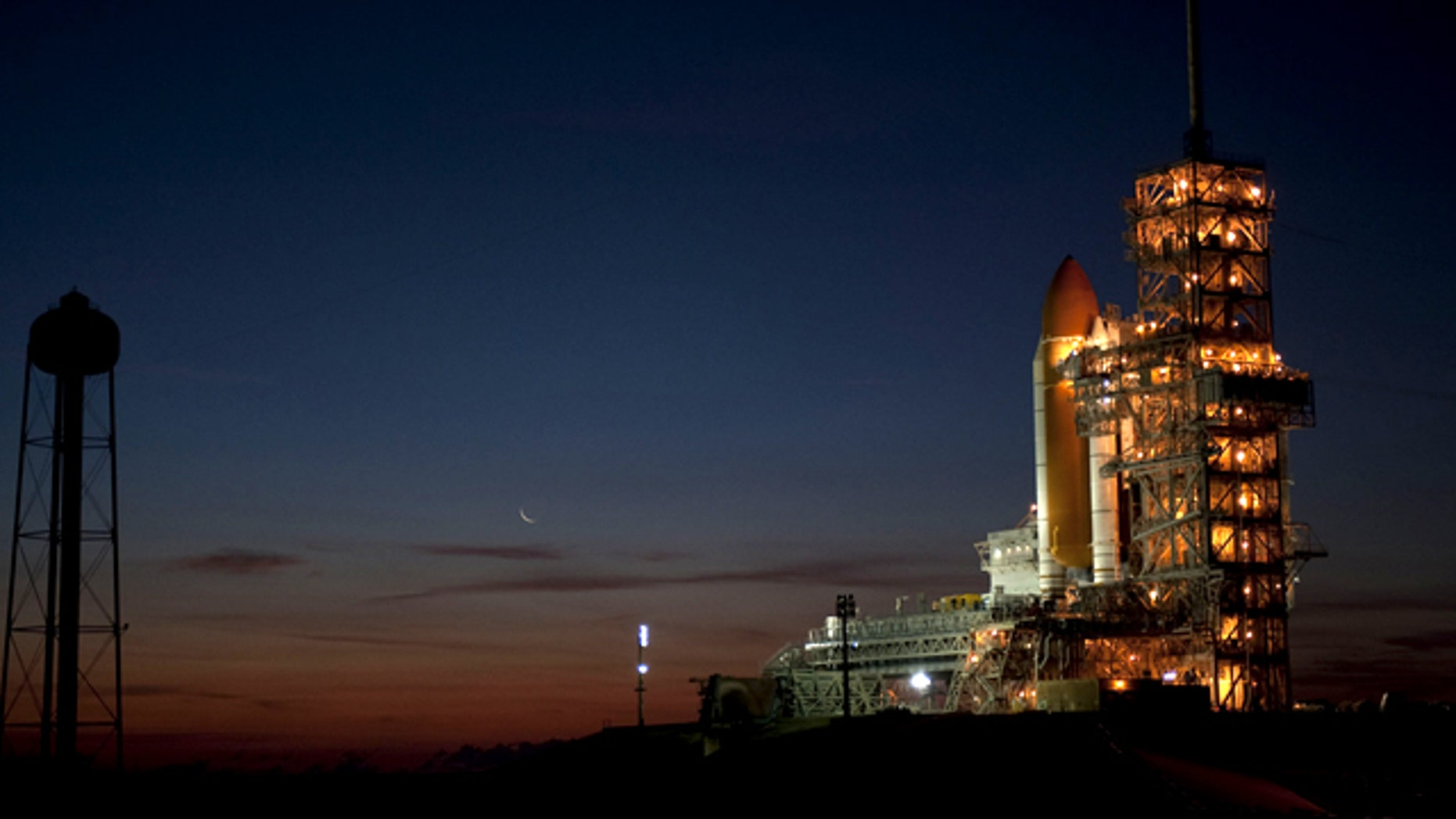 Space shuttle Discovery stands at Launch Pad 39A at NASA's Kennedy Space Center on Feb. 1, 2011 following its rollout from the Vehicle Assembly Building. The shuttle is due to launch on its final mission on Feb. 24.