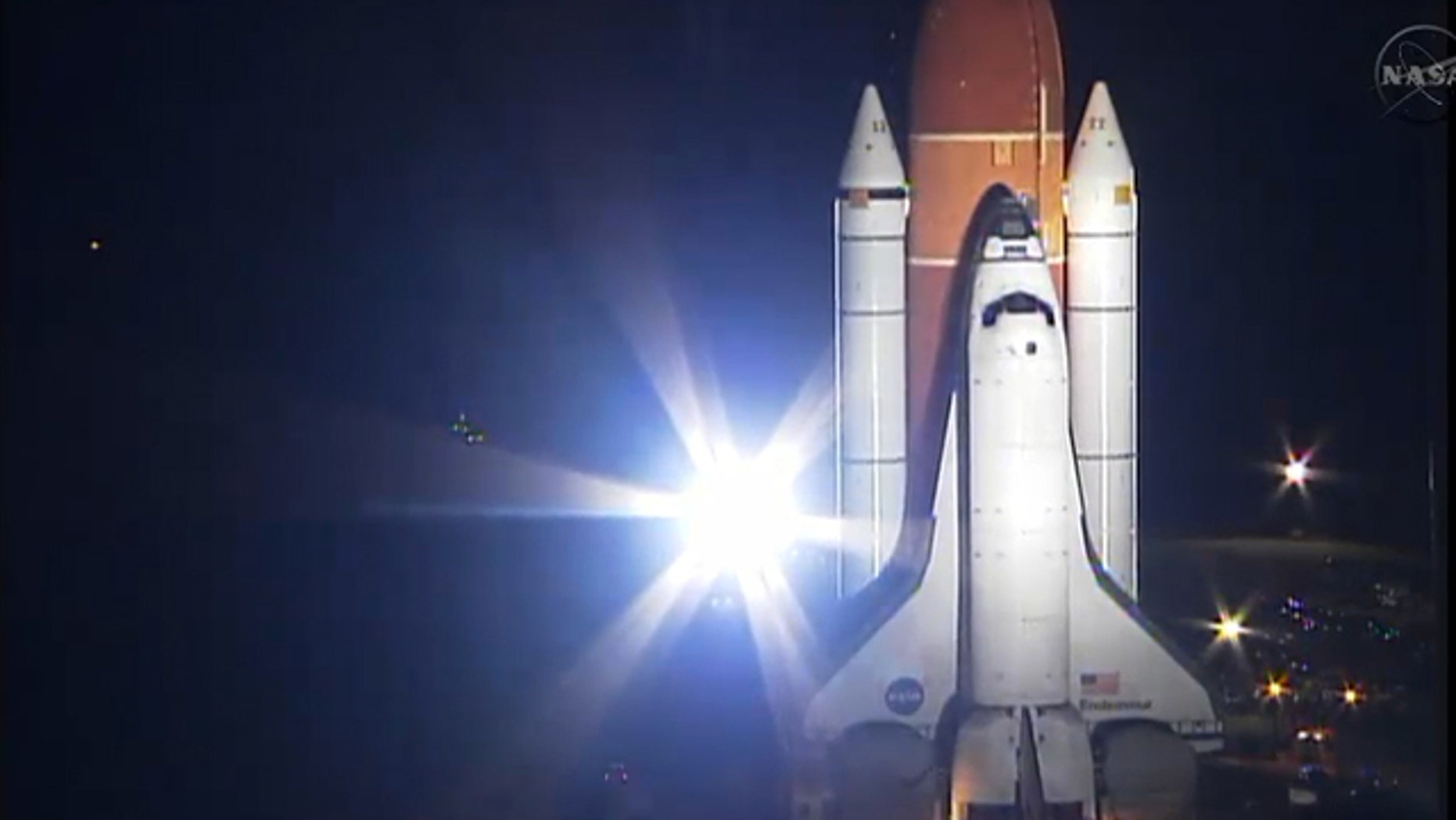 NASA's space shuttle Endeavour heads to the launch pad for its final mission, STS-134, while bathed in bright xenon spotlights on March 10, 2011 at NASA's Kennedy Space Center in Florida. Endeavour will fly its 25th and last mission during the STS-134 flight.