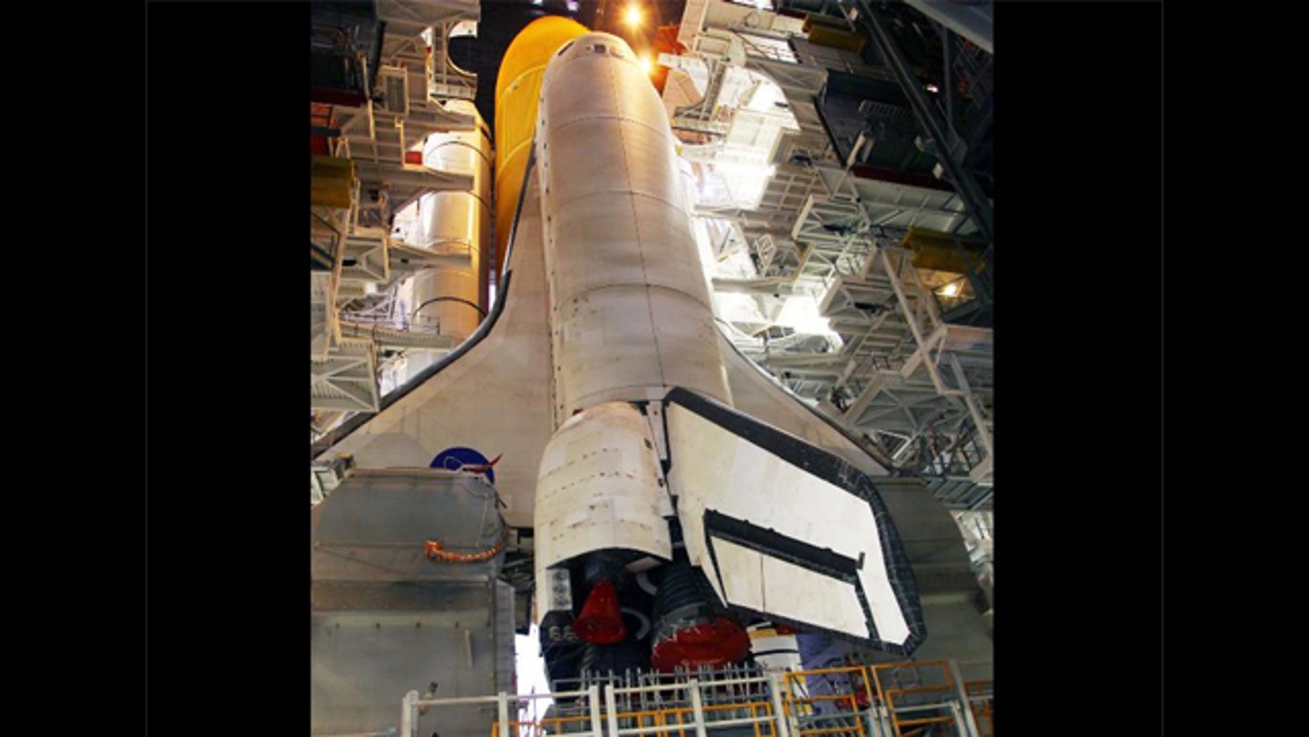 Work platforms inside the Vehicle Assembly Building at NASA's Kennedy Space Center in Florida surround the space shuttle Discovery, its solid rocket boosters and external fuel tank.