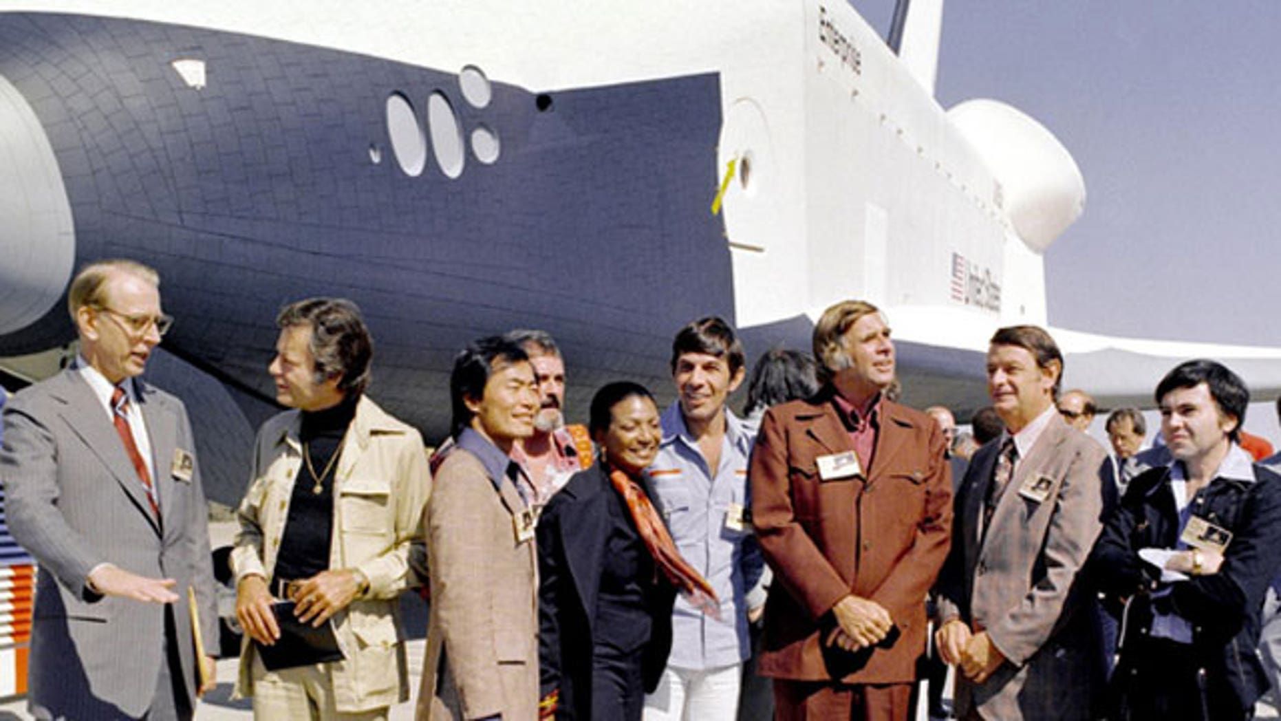 "n 1976, NASA's space shuttle Enterprise rolled out of the Palmdale manufacturing facilities and was greeted by NASA officials and cast members from the 'Star Trek' television series. From left to right they are: NASA Administrator Dr. James D. Fletcher; DeForest Kelley, who portrayed Dr. ""Bones"" McCoy on the series; George Takei (Mr. Sulu); James Doohan (Chief Engineer Montgomery ""Scotty"" Scott); Nichelle Nichols (Lt. Uhura); Leonard Nimoy (Mr. Spock); series creator Gene Rodenberry; an unnamed NASA official; and, Walter Koenig (Ensign Pavel Chekov)."