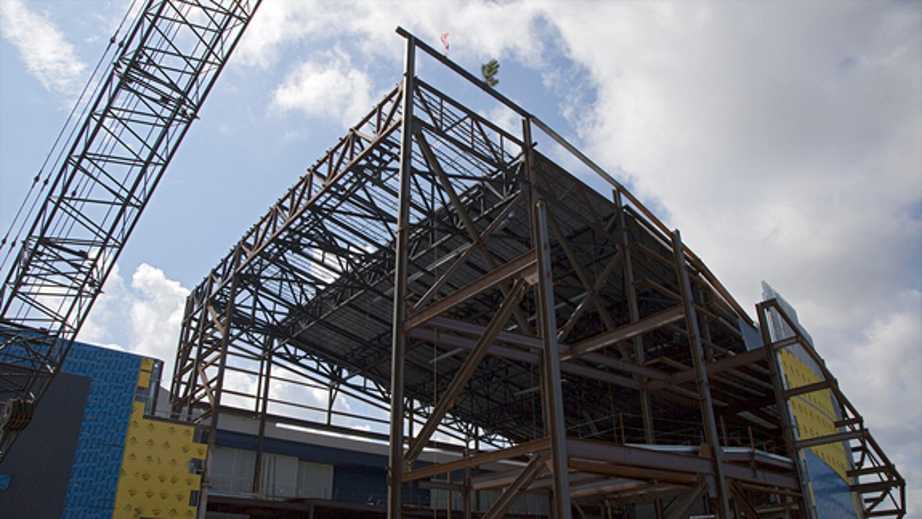 """A steel beam, temporarily """"topped out"""" with a tree, was fitted on Sept. 5, 2012, to the highest point of the exhibit facility for space shuttle Atlantis at the Kennedy Space Center Visitor Complex in Florida."""
