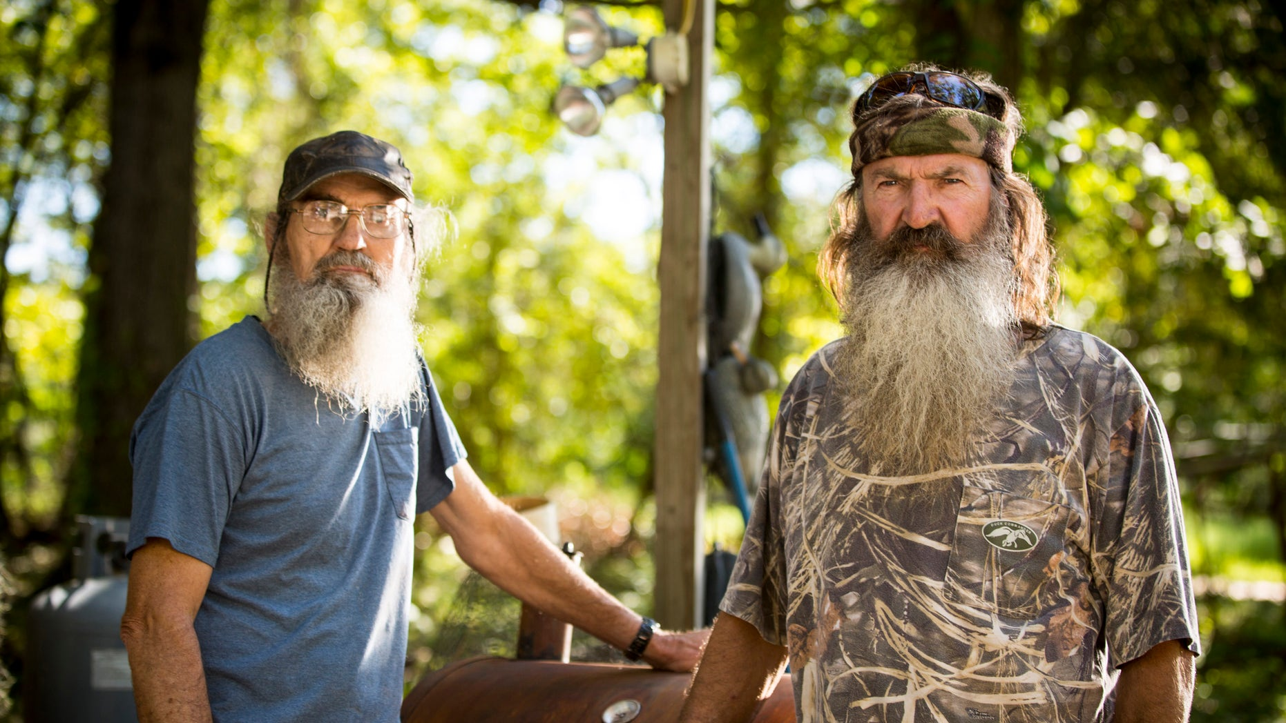 "This undated image released by A&E shows brothers Silas ""Uncle Si"" Robertson, left, and Phil Robertson from the popular series ""Duck Dynasty."""