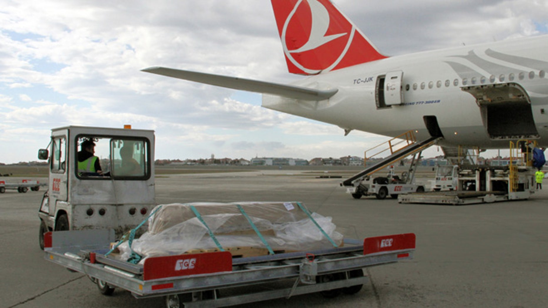 Feb. 7, 2013: Turkish airport ground service workers load a casket carrying the remains of New York City woman Sarai Sierra, 33, into a plane bound for New York at the Ataturk Airport in Istanbul, Turkey. (AP)
