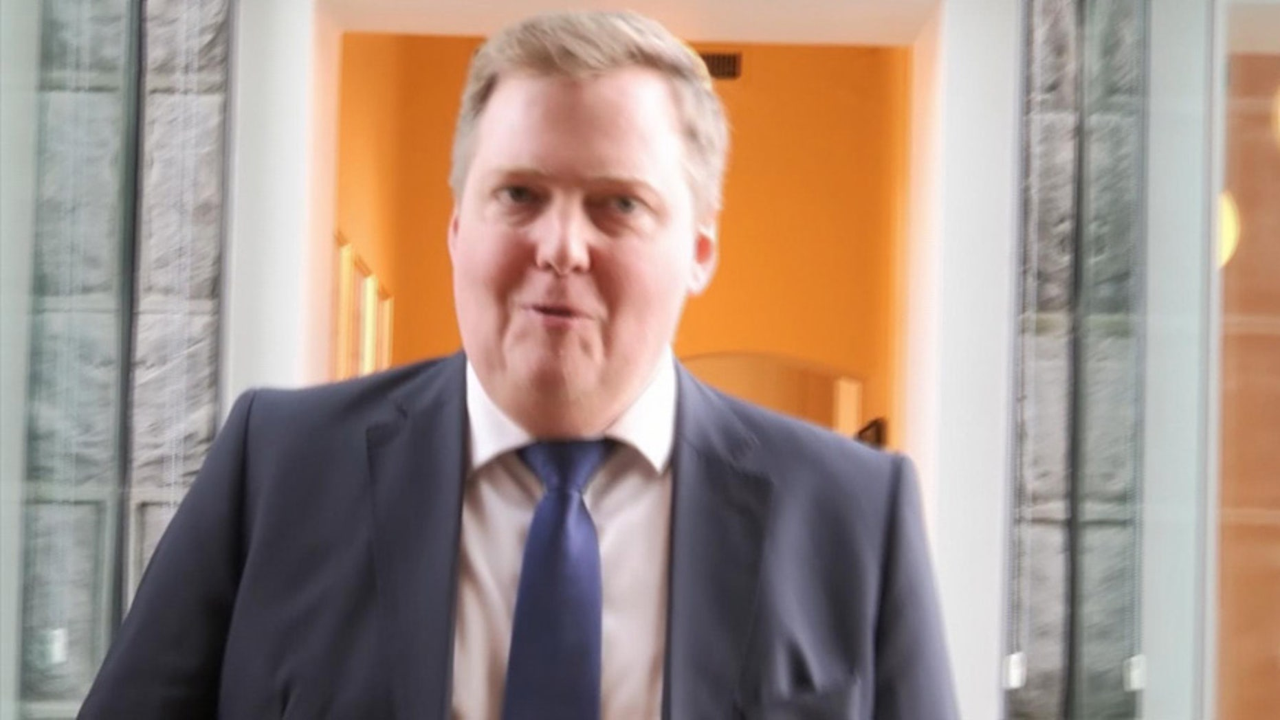 April 5, 2016: In this grab taken from video, Iceland's Prime Minister Sigmundur David Gunnlaugsson leaves after holding a meeting at Iceland's Parliament in Reykjavik.