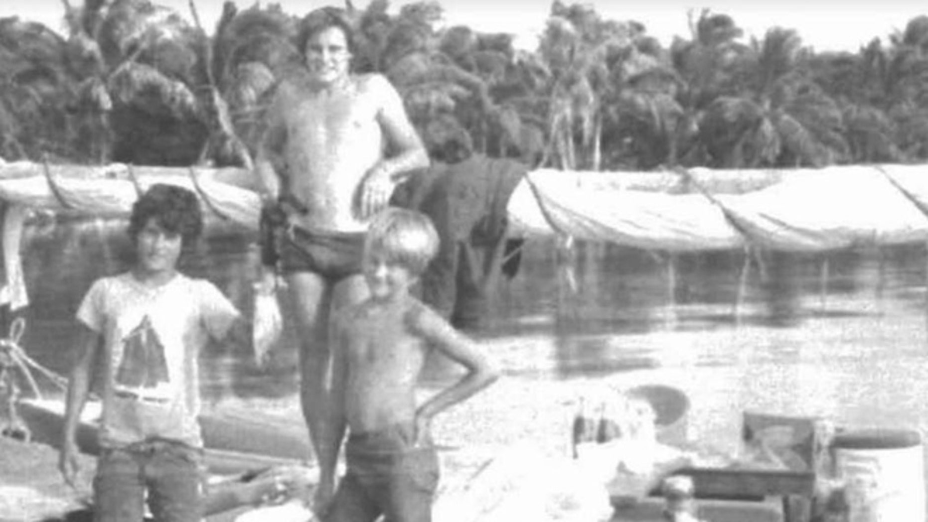 British tourist Christopher  Farmer with the sons of Silas Duane Boston in a 1978 photo. (Sacramento U.S. Attorney's Office)