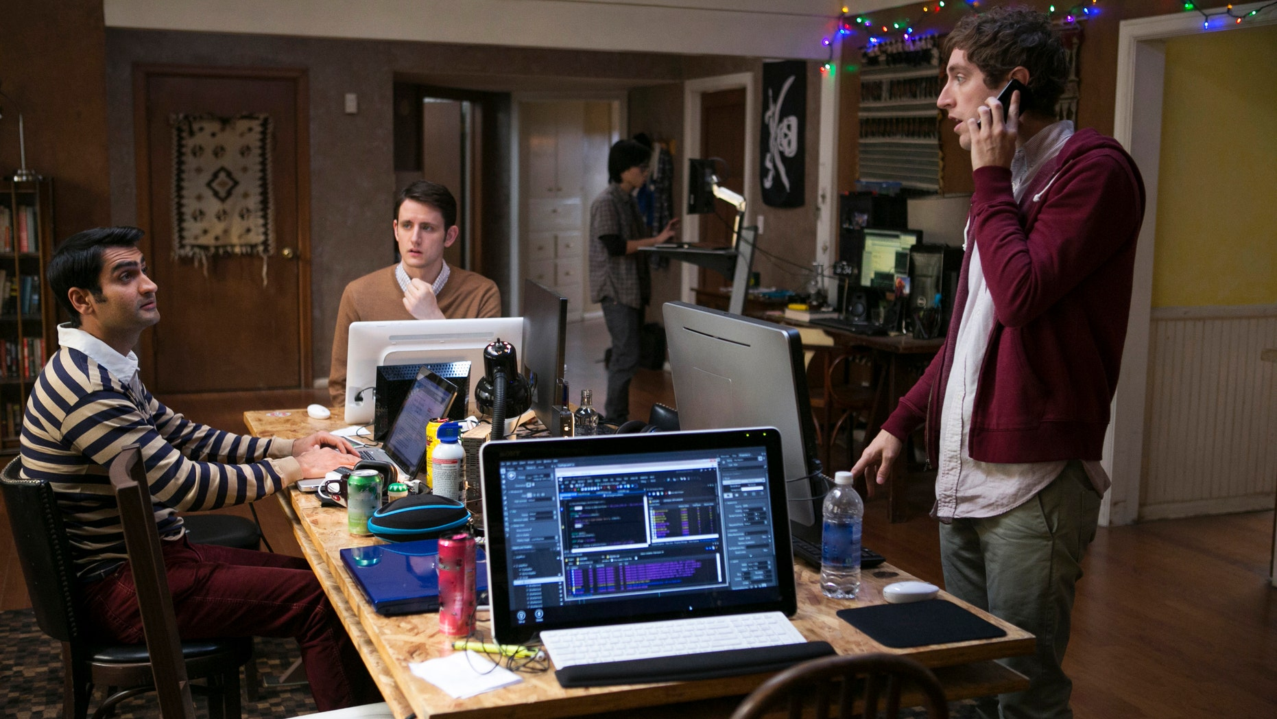 """Kumail Nanjiani, Zach Woods, and Thomas Middleditch, in a scene from the television series,""""Silicon Valley."""""""