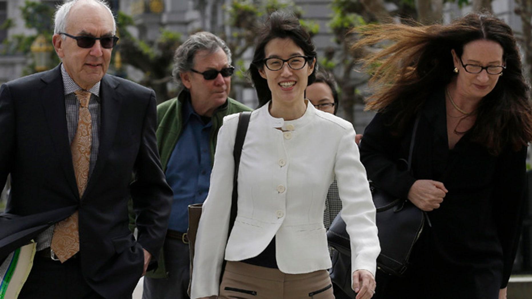 Mar. 17, 2015: Ellen Pao, center, walks to Civic Center Courthouse in San Francisco (AP)