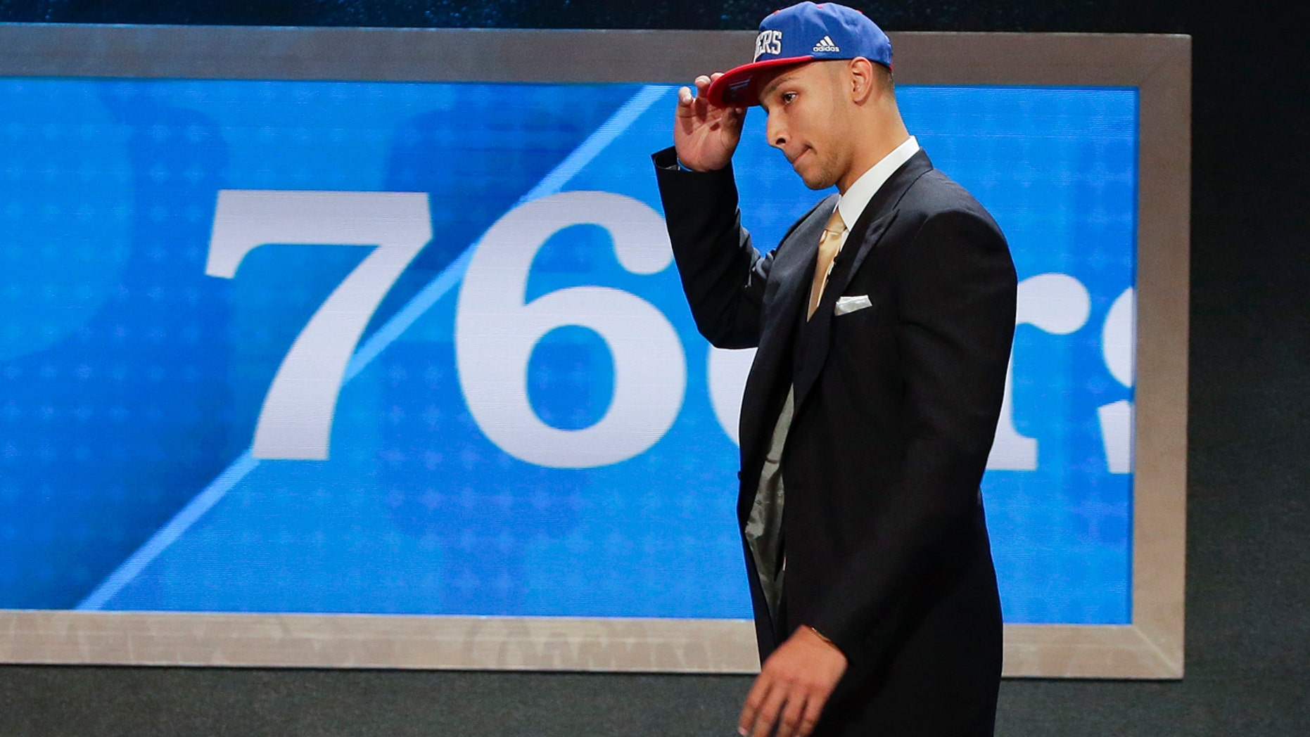June 23, 2016: LSU's Ben Simmons walks up on stage after being selected as the top pick by the Philadelphia 76ers during the NBA Draft in New York.