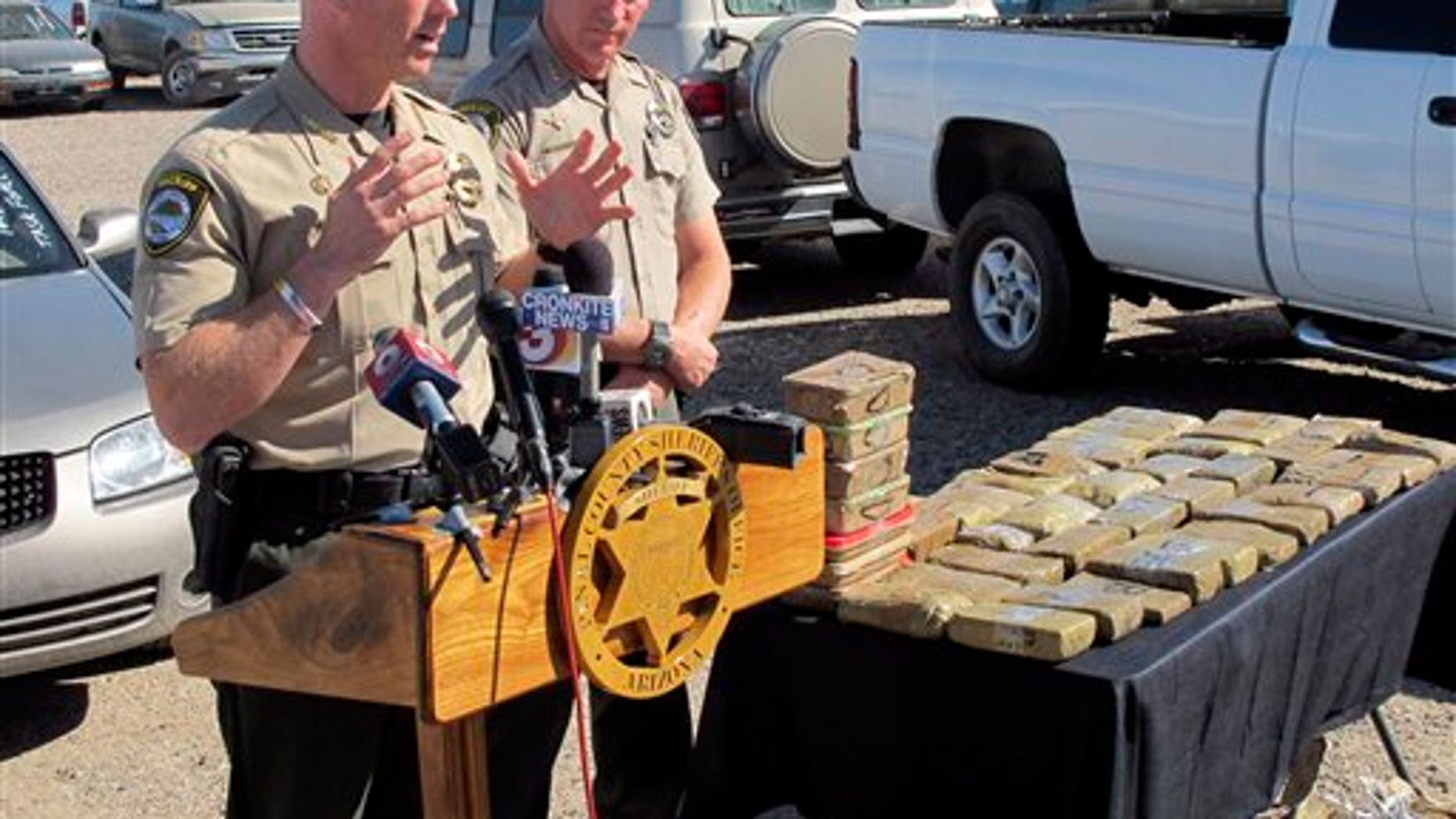 Nov. 1, 2011: Pinal County Sheriff Paul Babeu, left, and Chief Deputy Steve Henry discuss the Arizona arrest of a member of Mexico's Sinaloa drug cartel at a news conference in Florence, Ariz. Babeu says that the man was caught Monday, two weeks after he was deported as part of a larger investigation into the cartel.