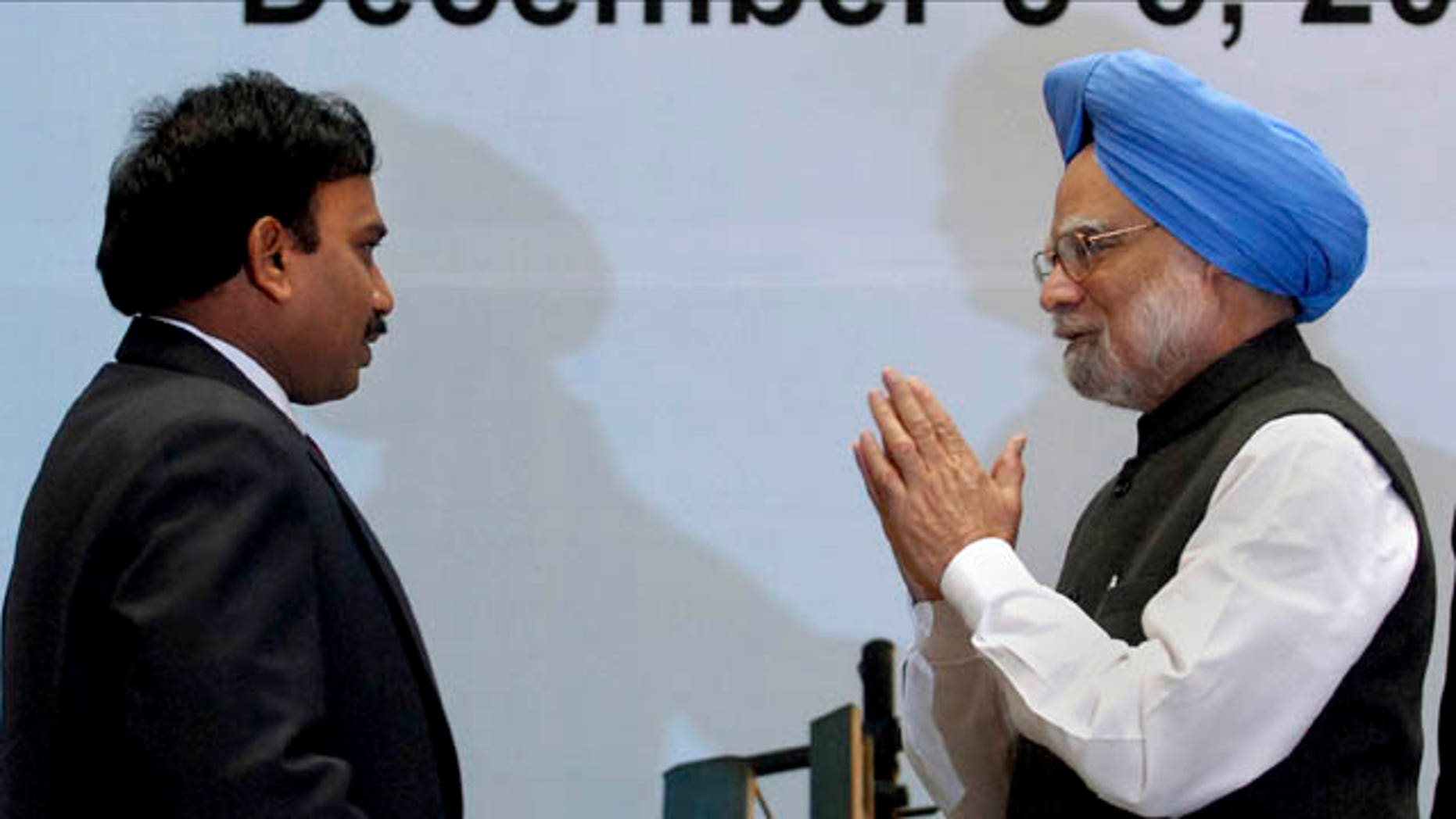 This Dec. 4, 2009 file photo shows Indian Prime Minister Manmohan Singh, right, greeting then Telecoms Minister Andimuthu Raja in New Delhi, India. India's ruling Congress party was Sunday trying to resolve differences with a key regional ally that has withdrawn its ministers from the government. Raja allegedly sold the 2G mobile phone spectrum at throwaway prices in 2008 leading to losses of $36 billion in potential revenue by not auctioning the licenses. Raja's arrest and searches at his home and at the offices of a television network owned by the DMK have strained relations between the government and its ally. (AP/Tribhuvan Tiwari/Outlook)