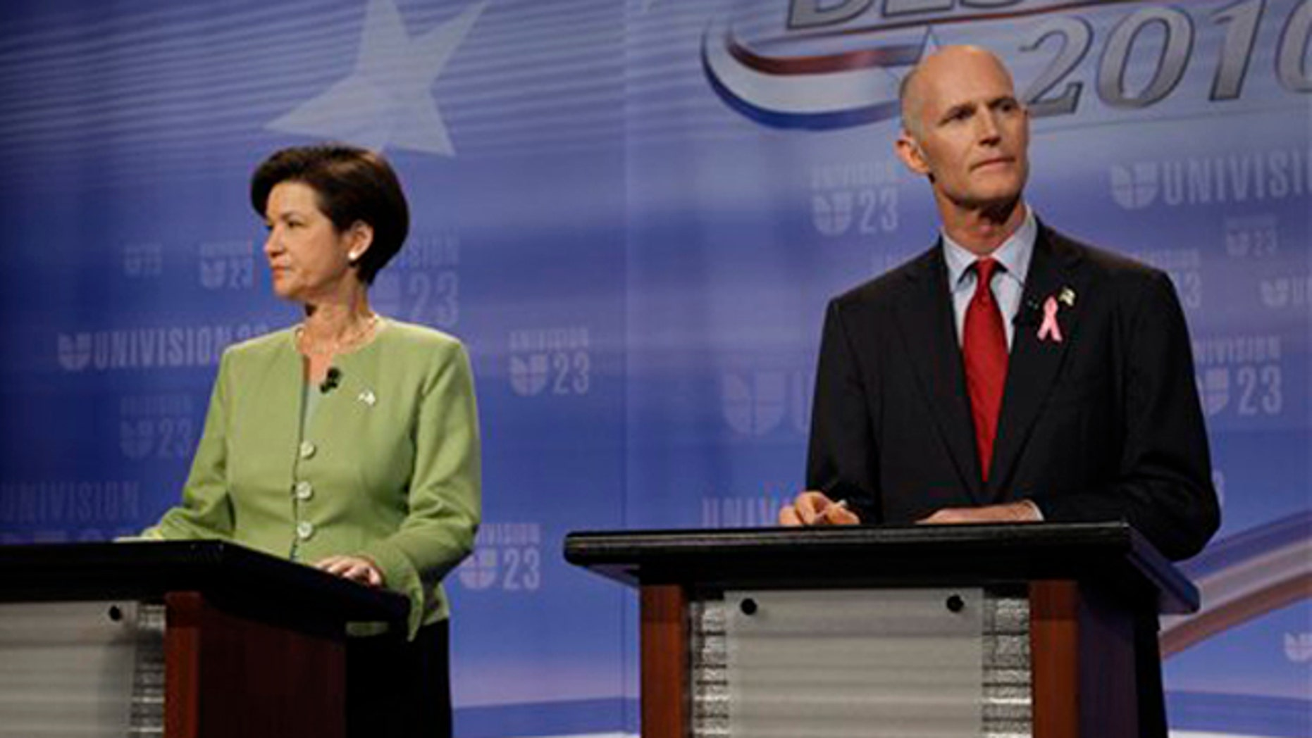 Candidates for Florida governor Alex Sink, left, and Rick Scott meet for their first face-to-face debate at Univision's studios in Miami Oct. 8. (AP Photo)