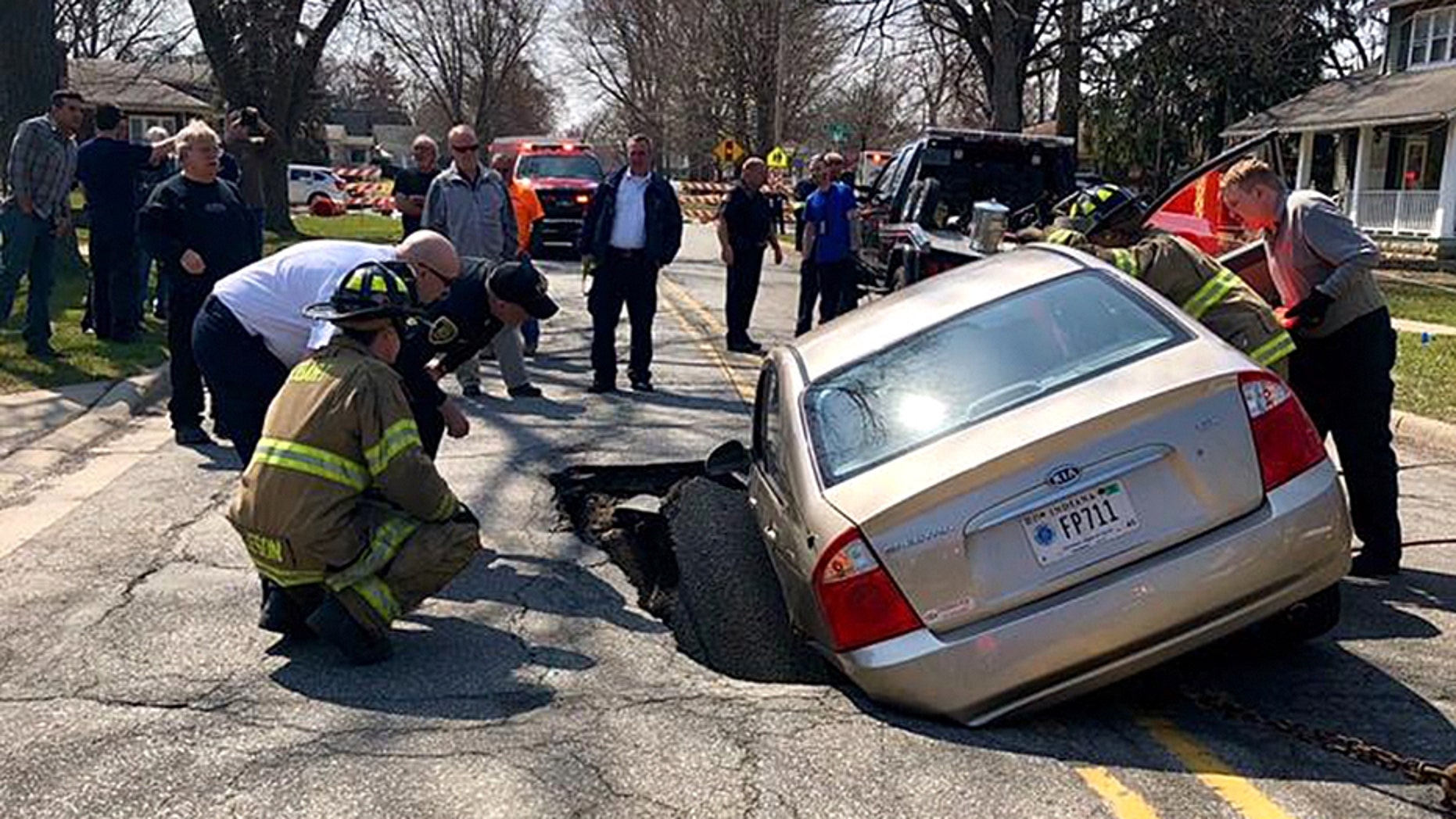 A car ended up in a large sinkhole in northwest Indiana on Wednesday.